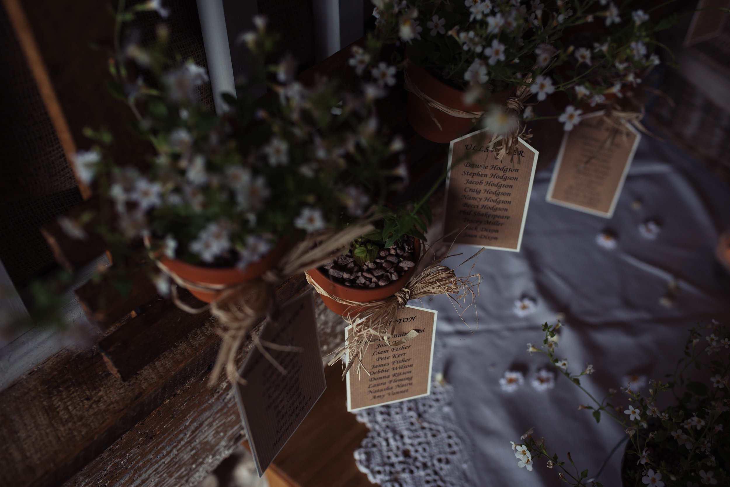 Rustic and bushy table decorations in the barn at Askham Hall