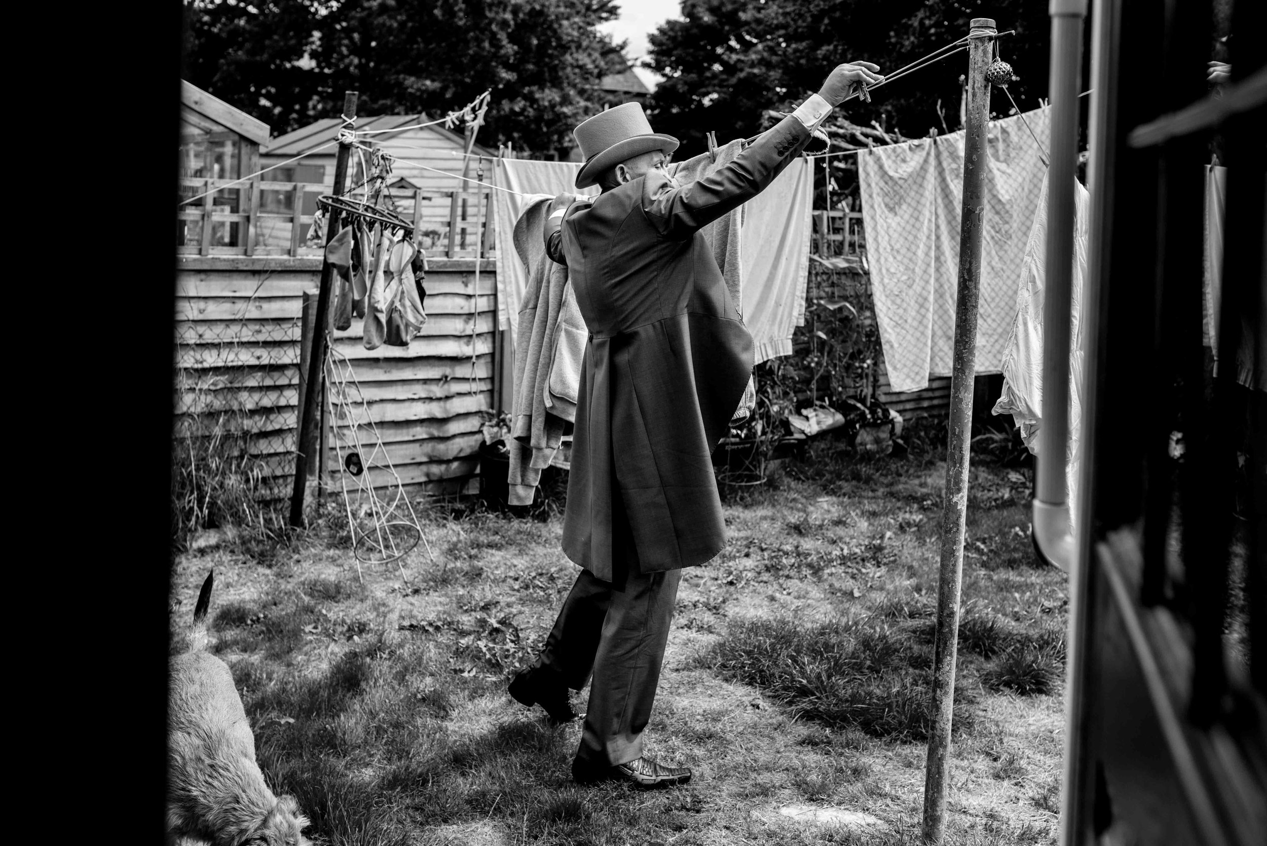 Groom hangs his washing out on the morning of the wedding