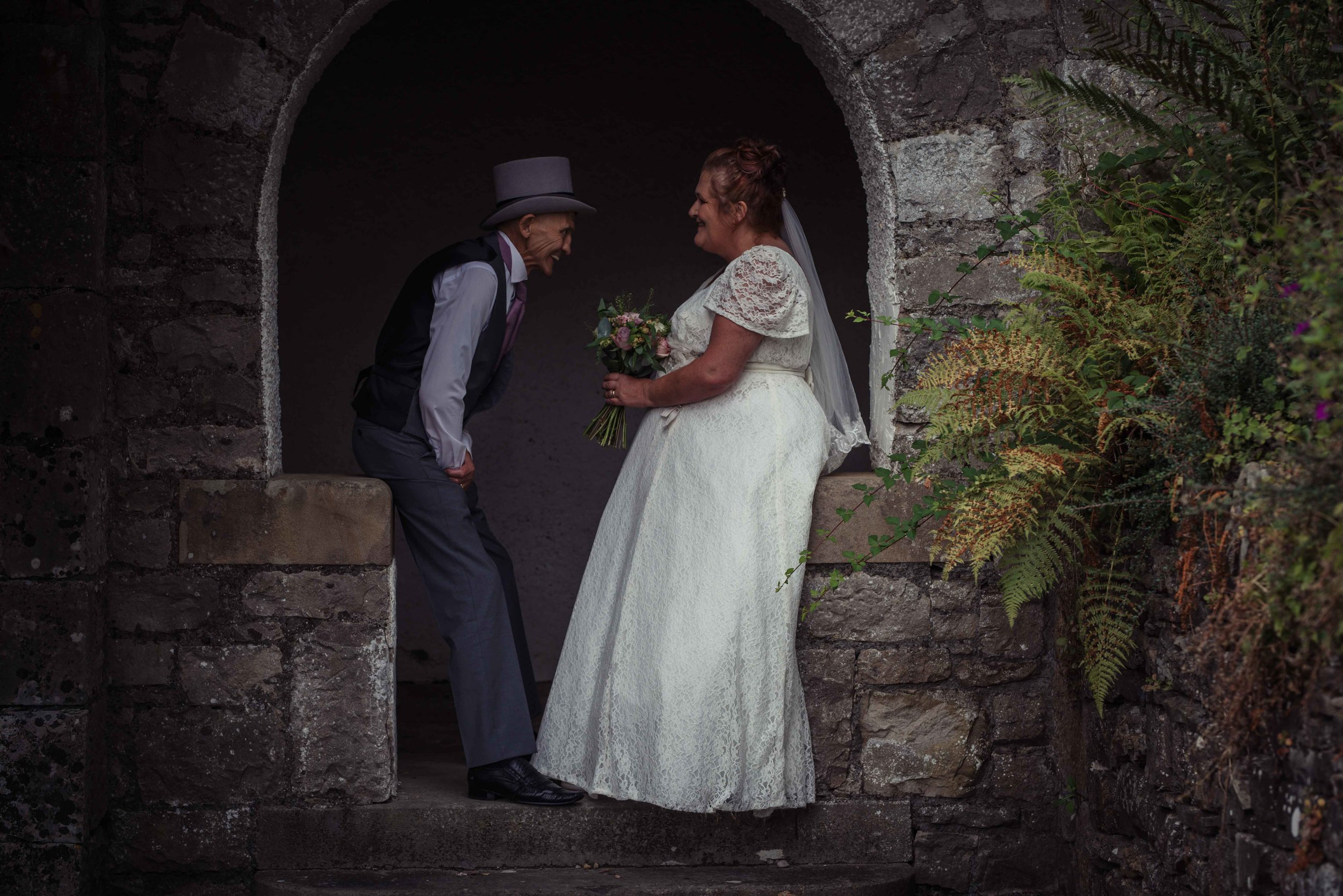 The bride and groom have an intimate moment together during their wedding photography at the castle green hotel