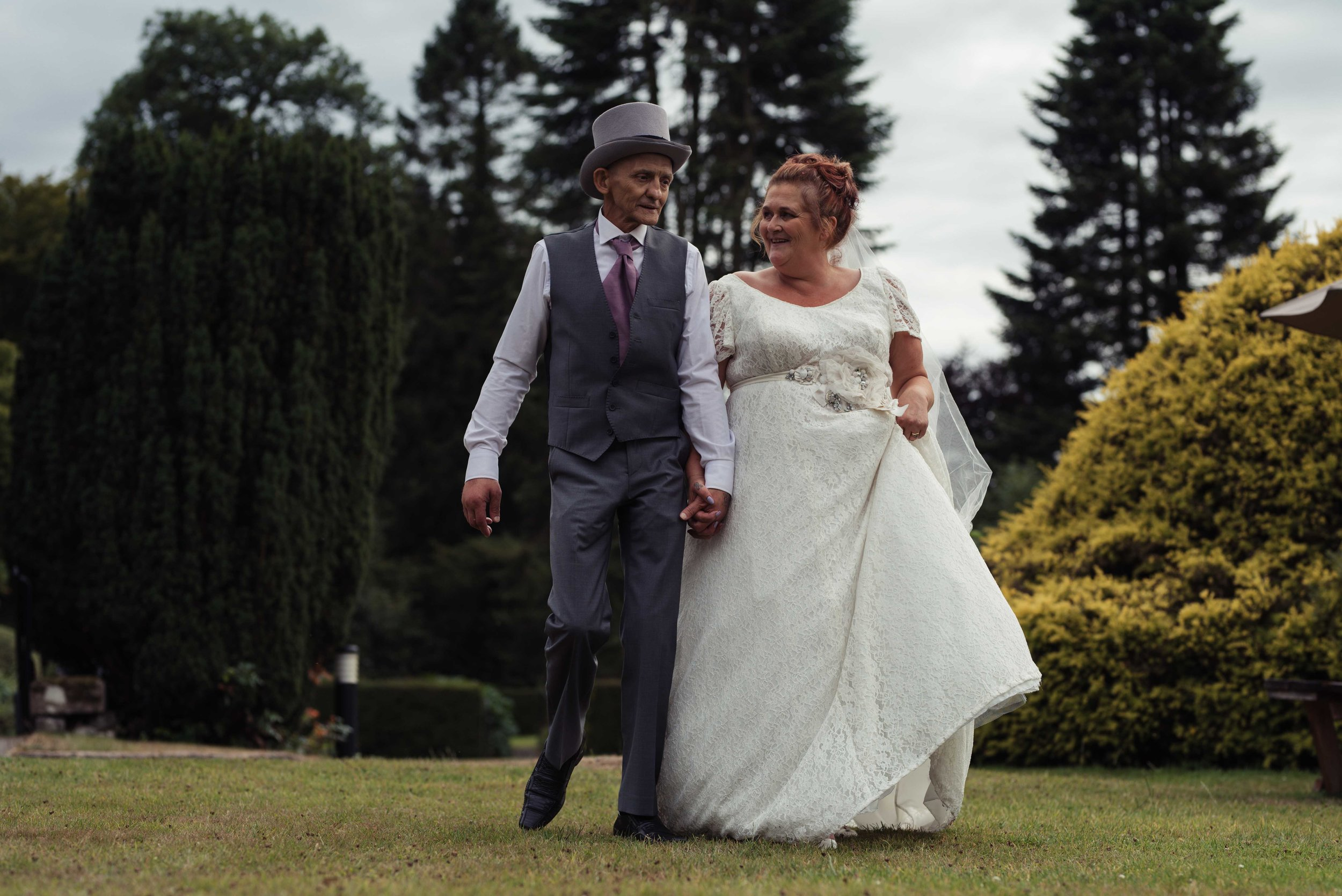 The bride and groom walk together during their lake district wedding photography portrait session