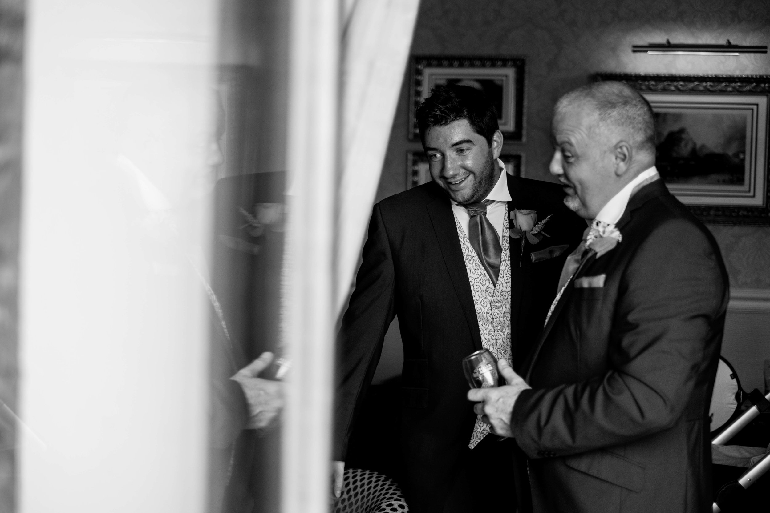 The groom chats with the registrar before the ceremony