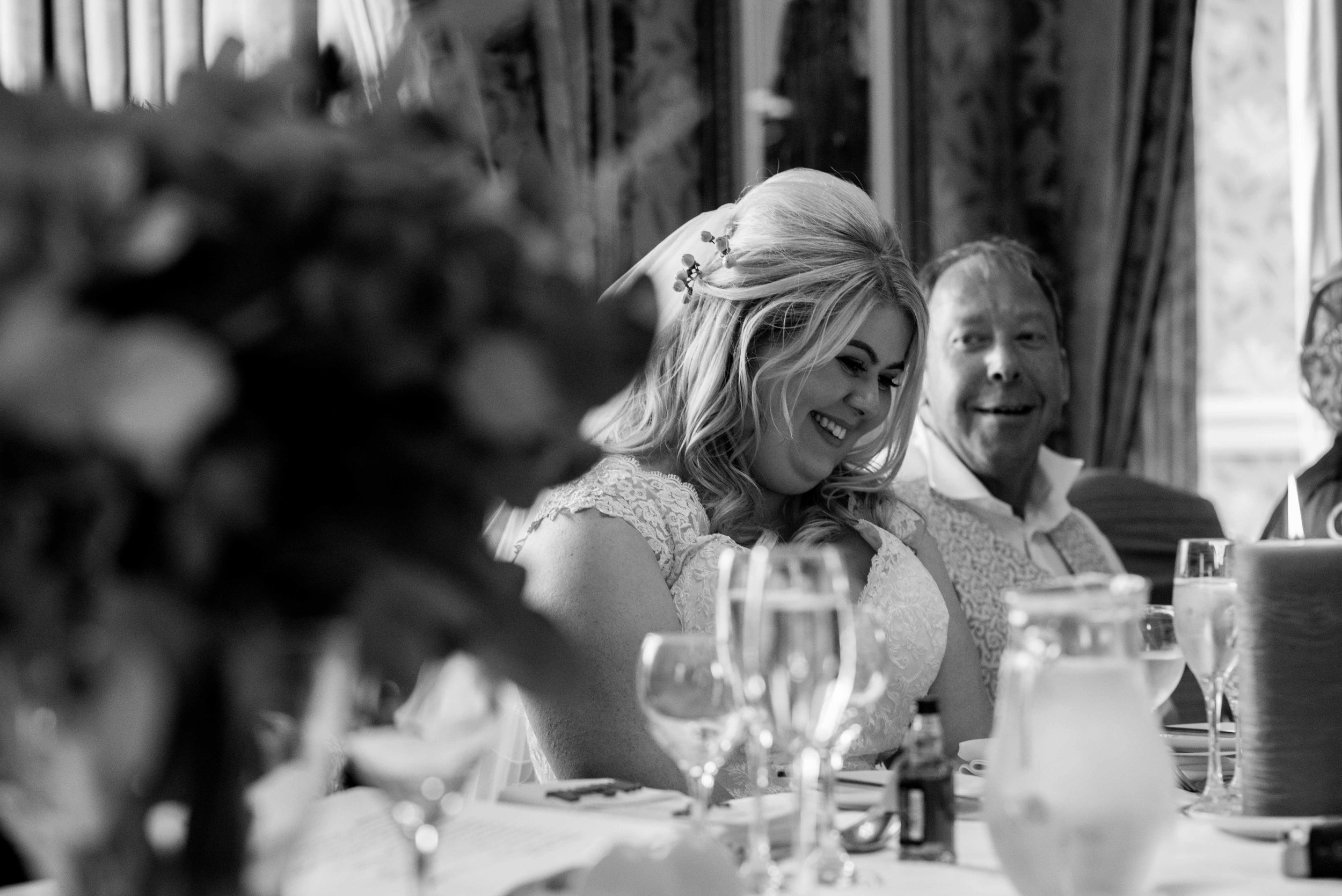 The bride has a giggle during the father of the bride speech