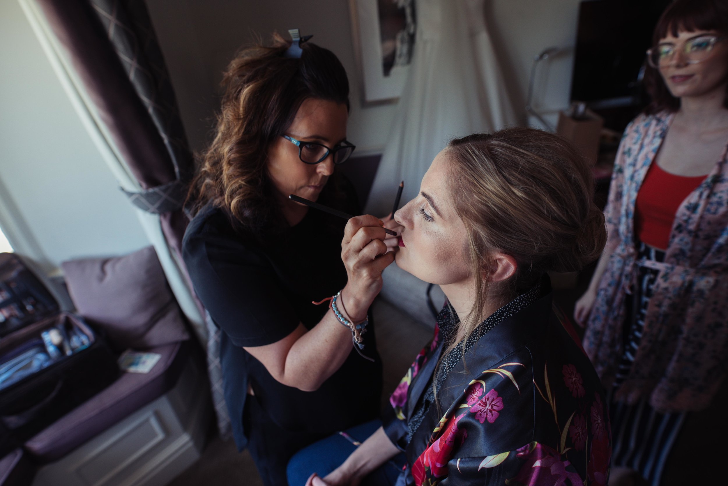 The bride having her make up done at Rookery Hall