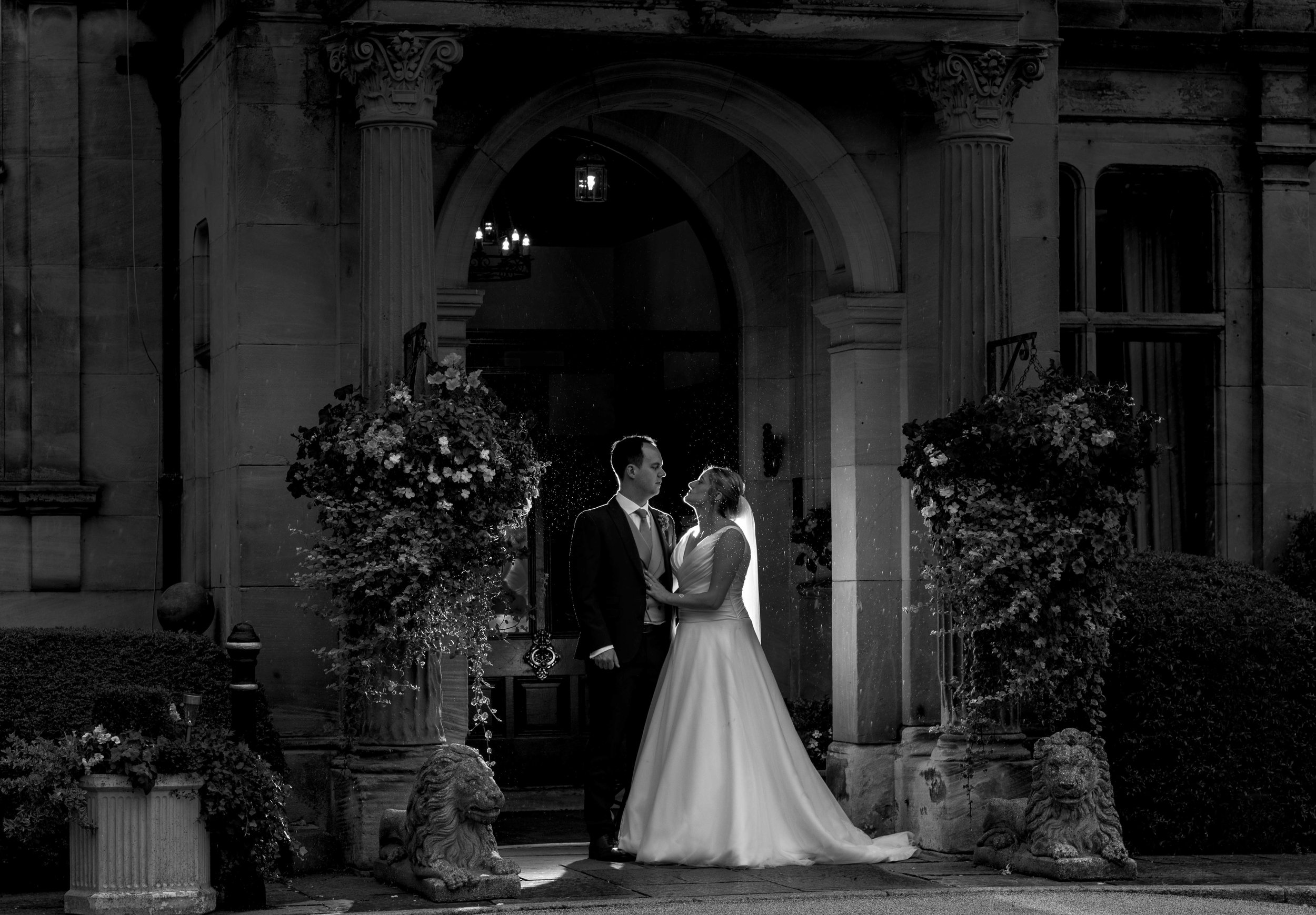 The bride and groom in the entrance to rookery hall