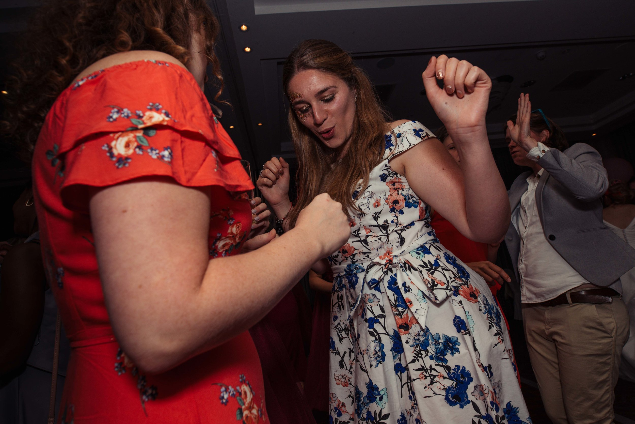 A wedding guest having a dance on the dance floor