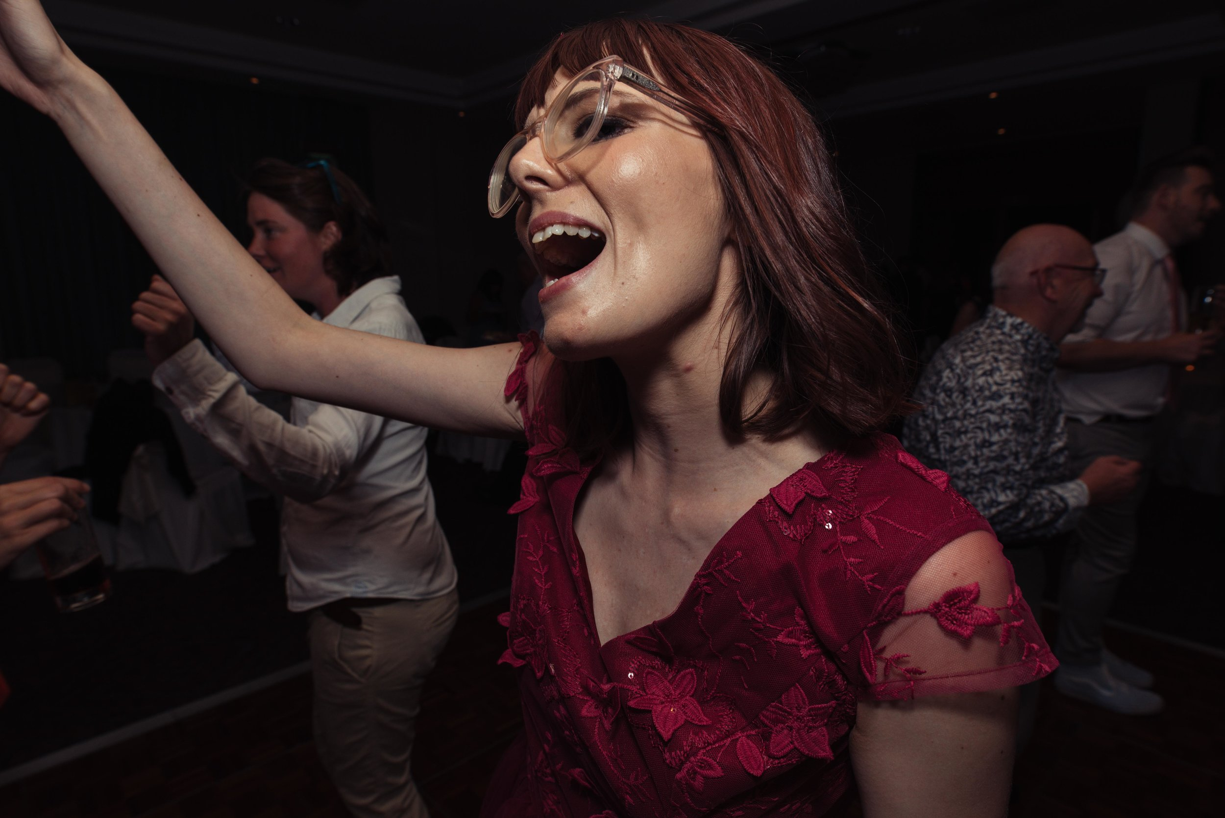 A bridesmaid lets her hair down on the dance floor