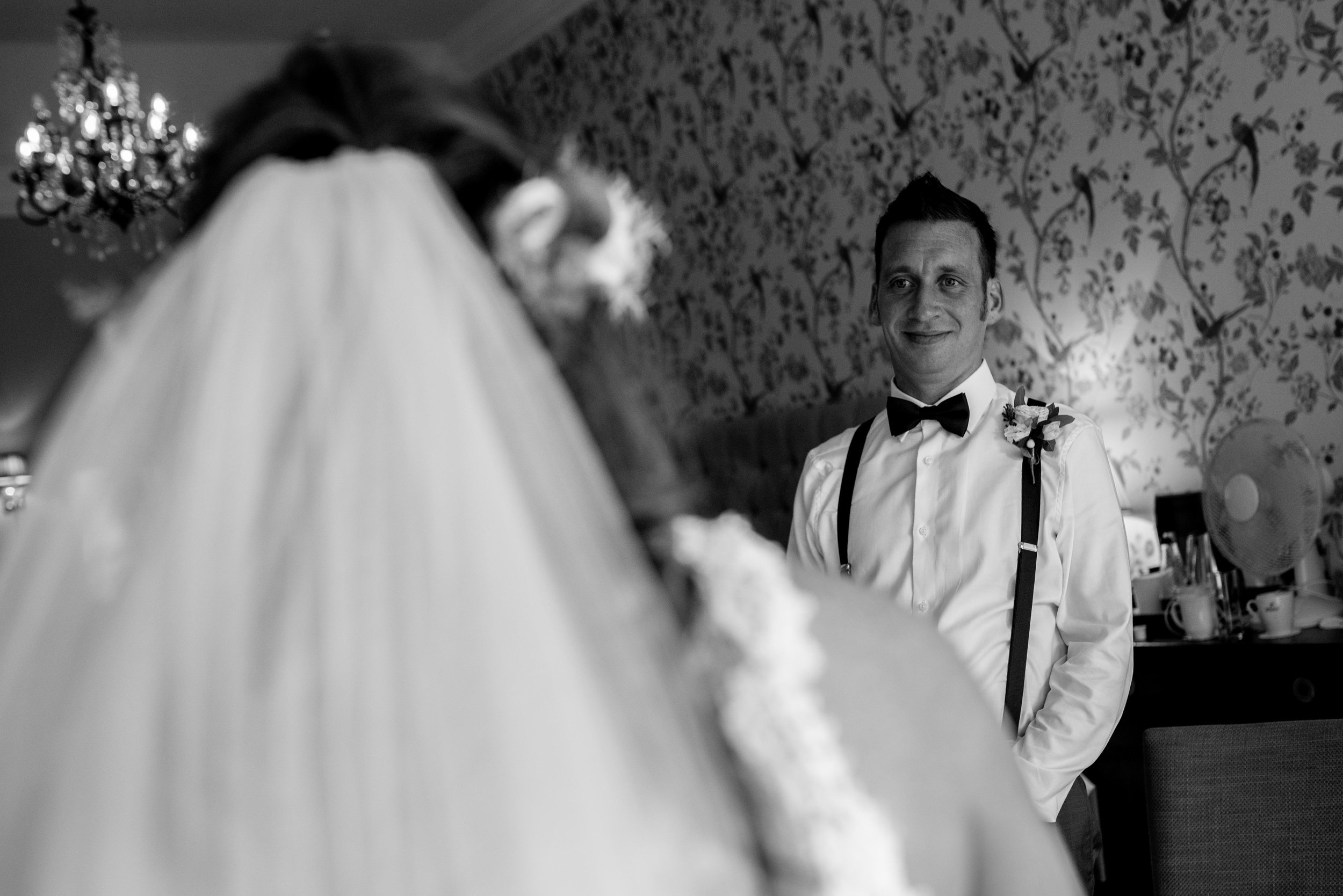 The brother of the bride sees his sister in a dress for the first time