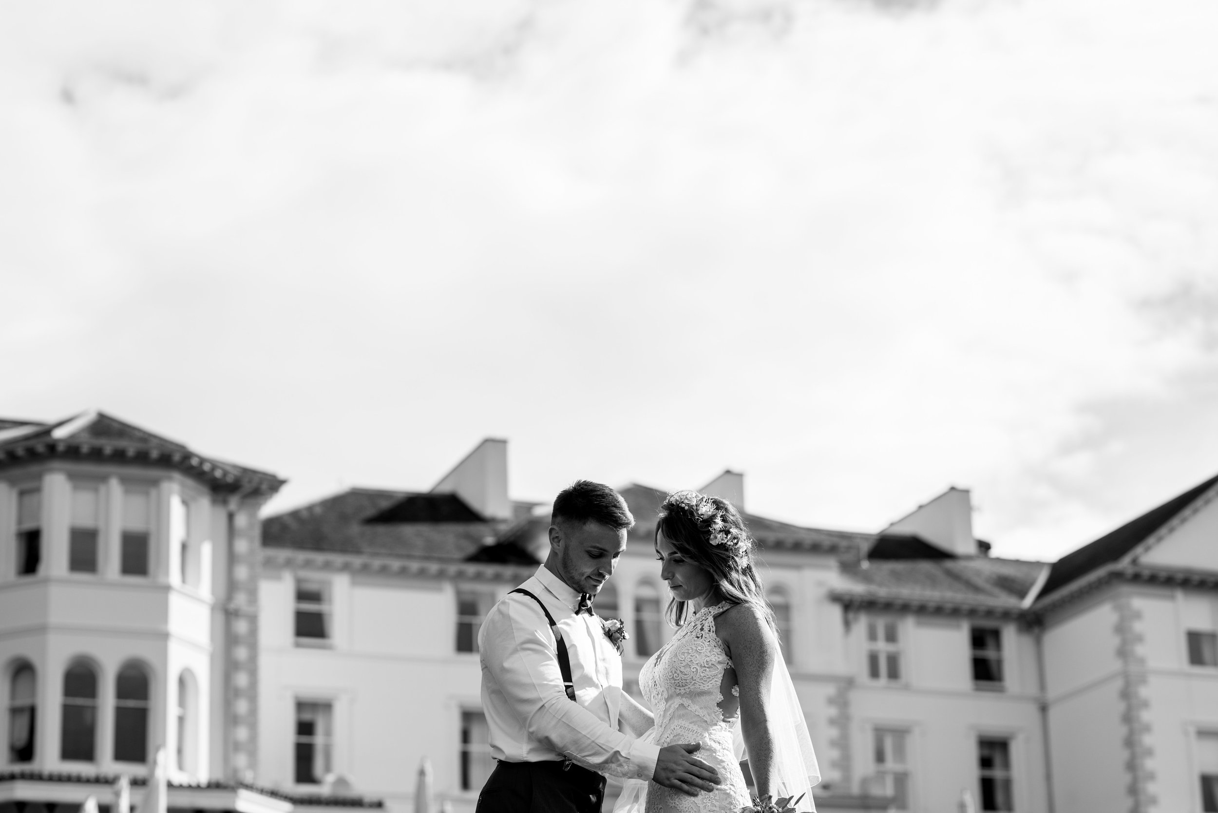 Bride and groom in black and white with the Lake District Belsfield in the background