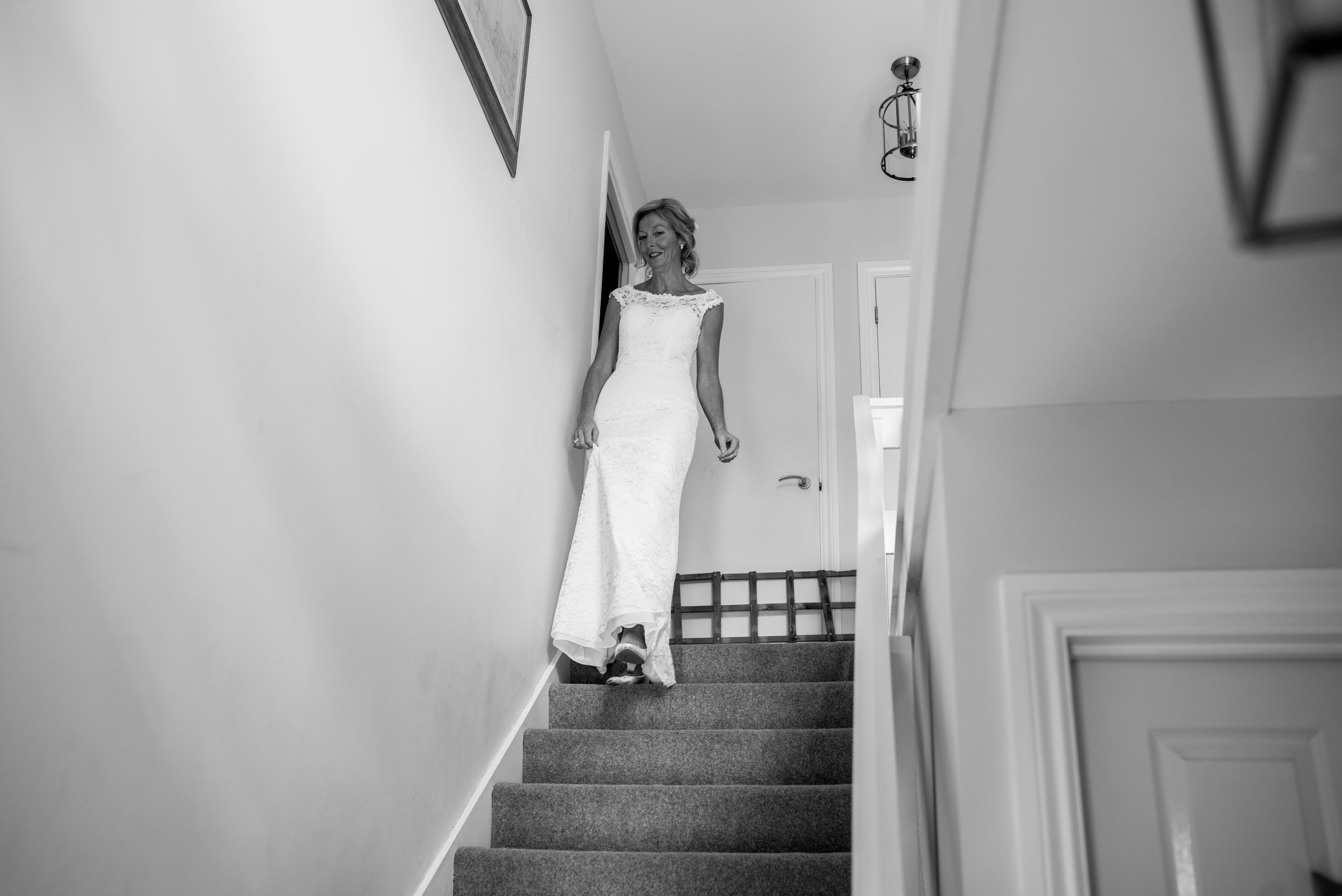 The bride makes her way down the stairs