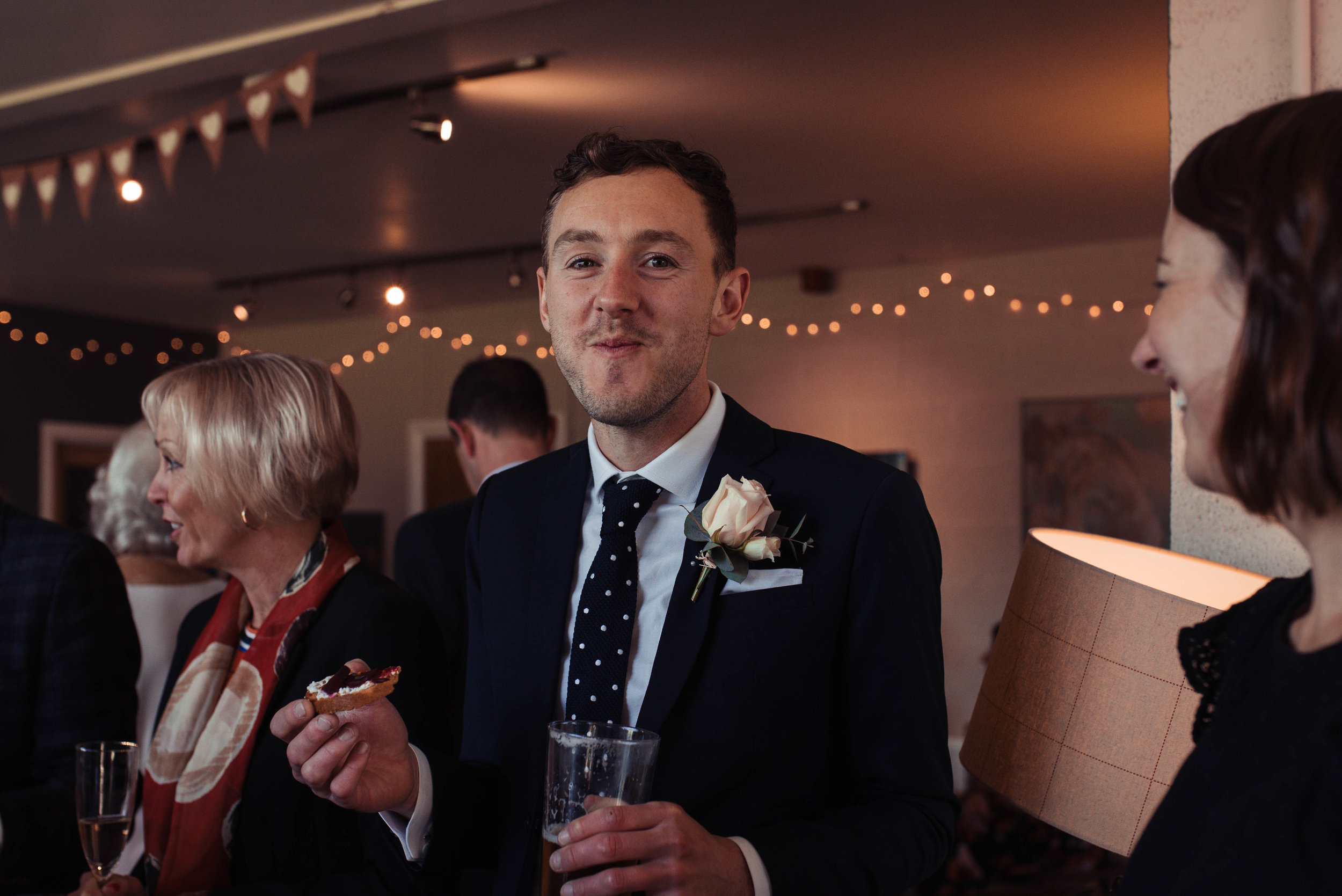 The camera catches the best man just as he's about to eat a canapes