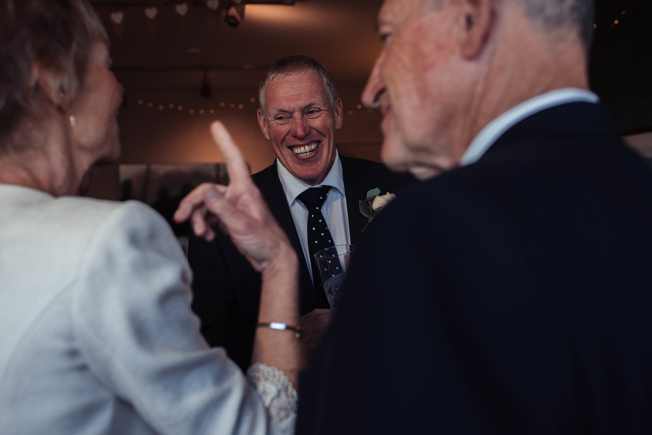 A wedding guest howls laughing
