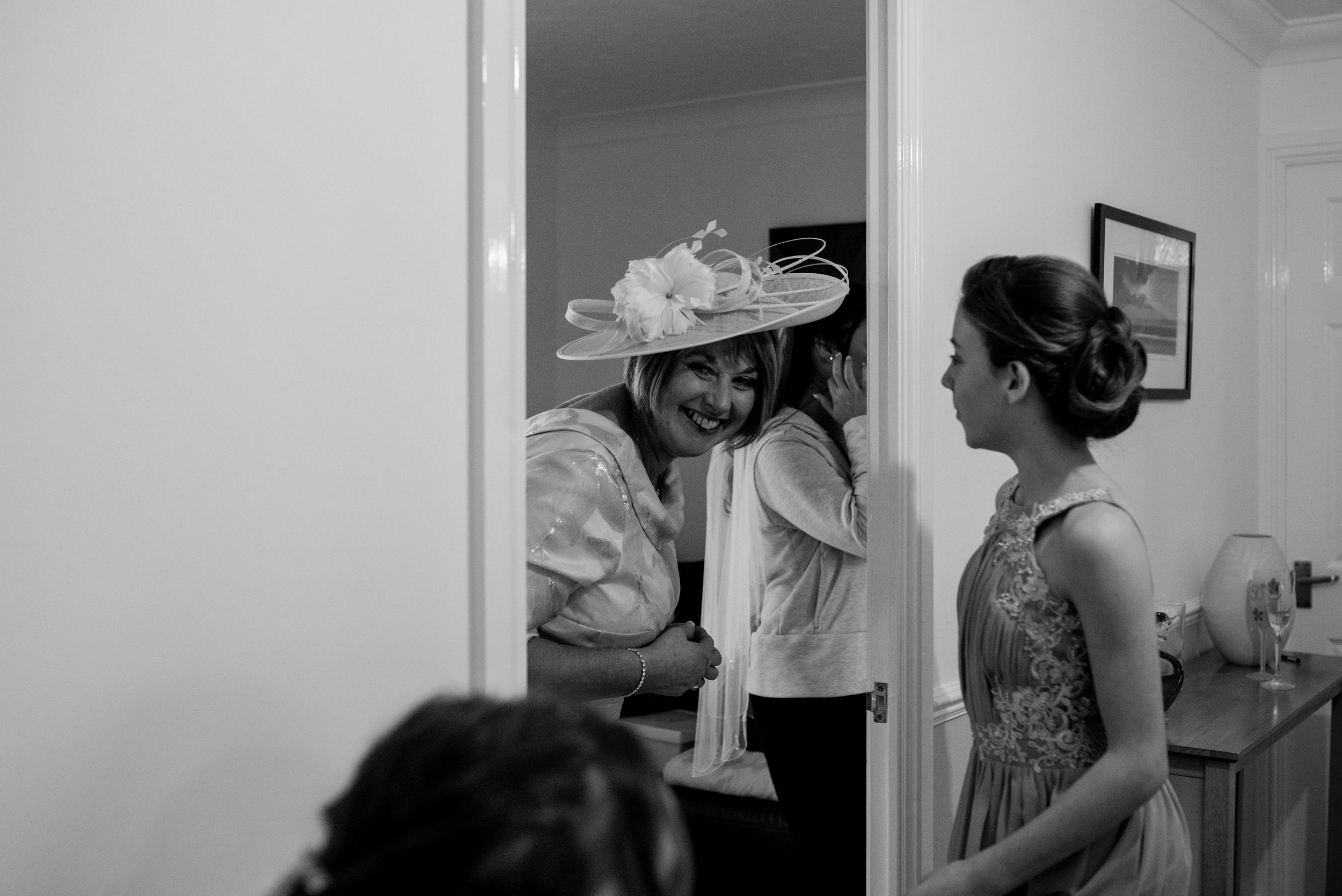 The brides mother peeps around the corner