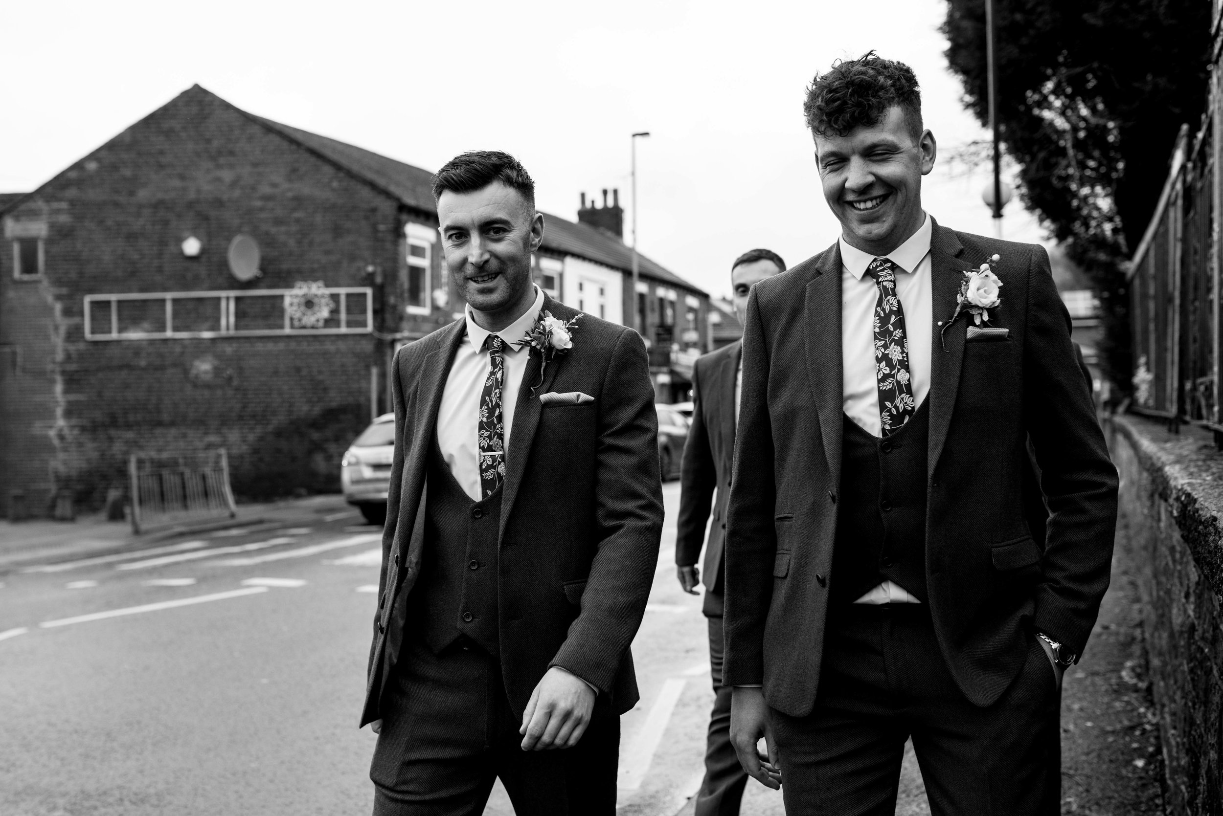 The groom and his men walking to church from the pub