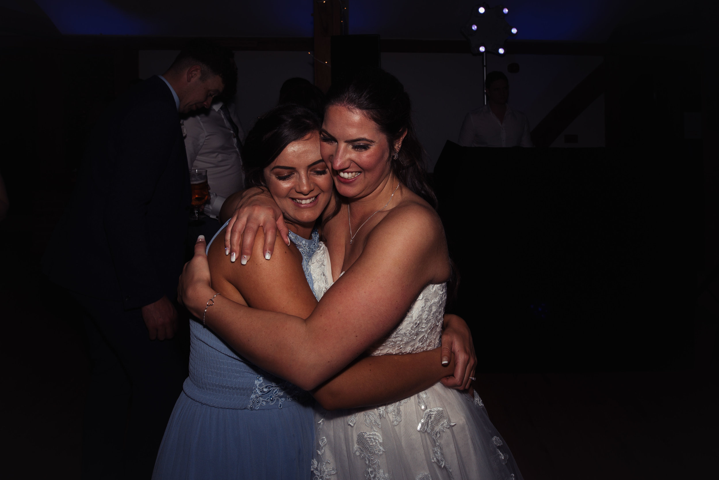 The bride hugs her maid of honour