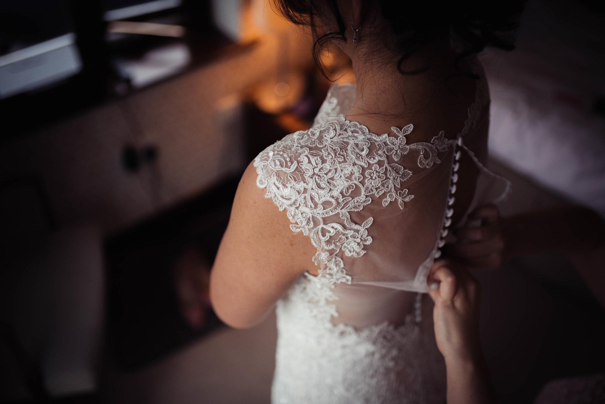 Details on the brides lace dress