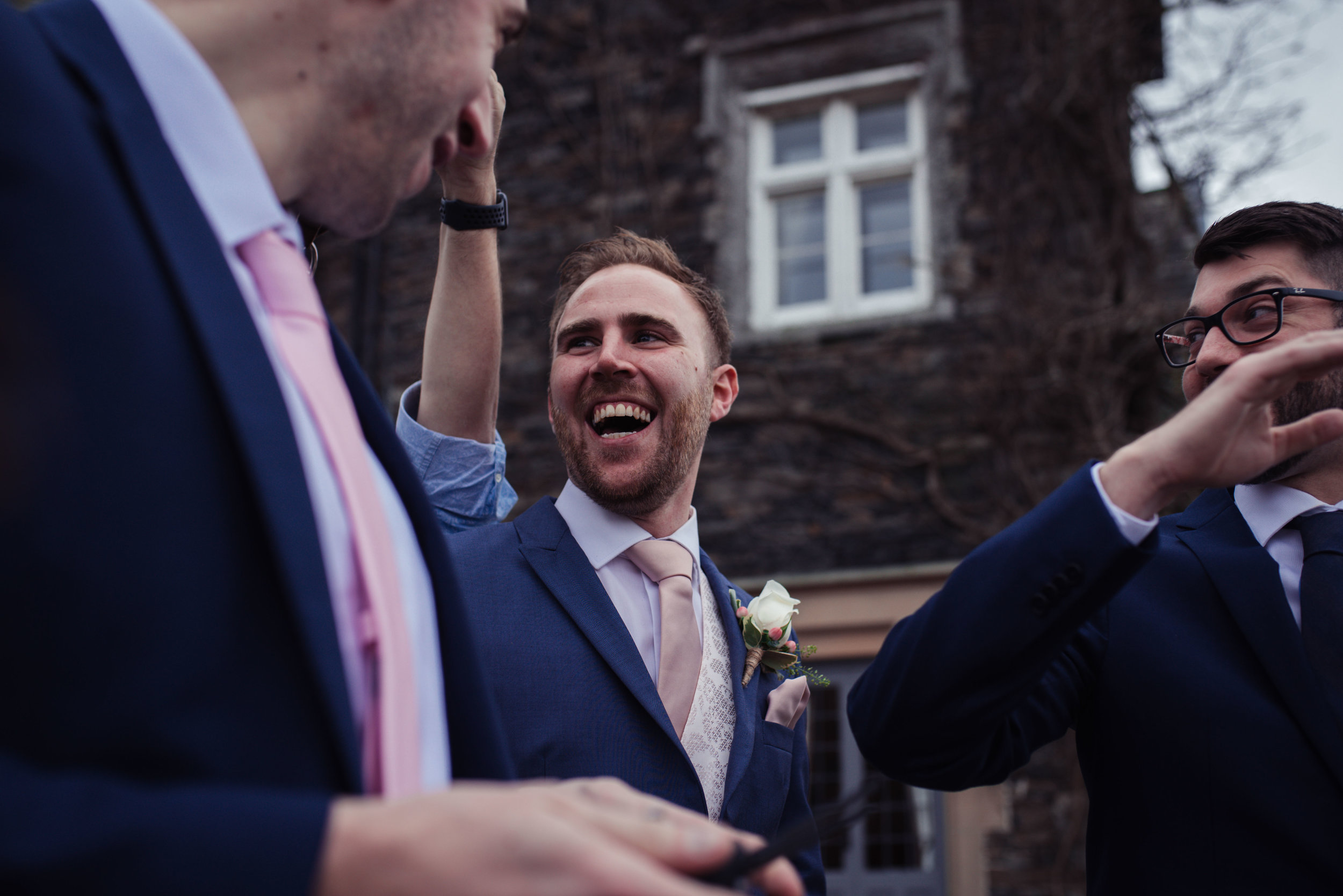 The brother of the bride laughing his head off