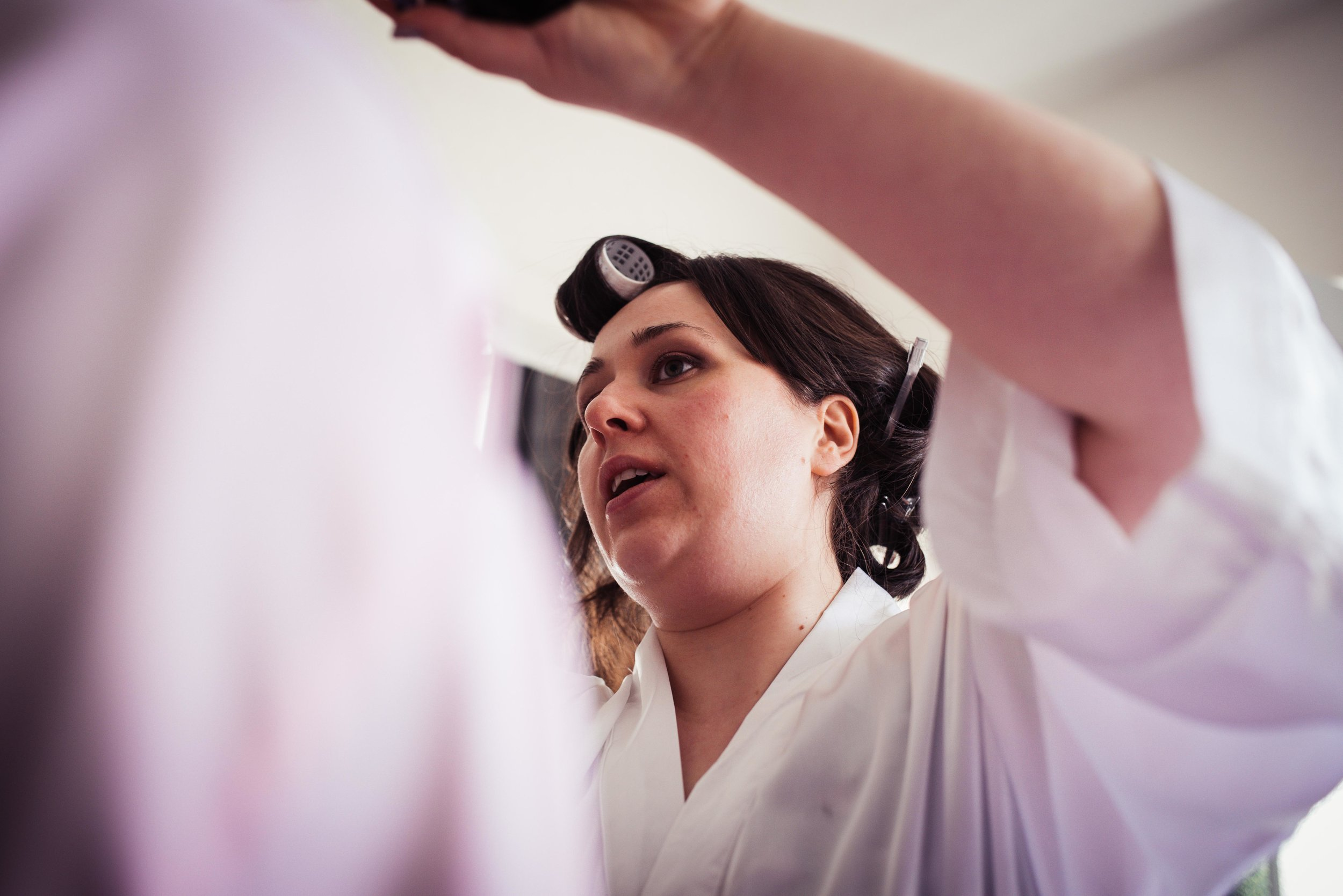Concentrating bride on the morning of the wedding