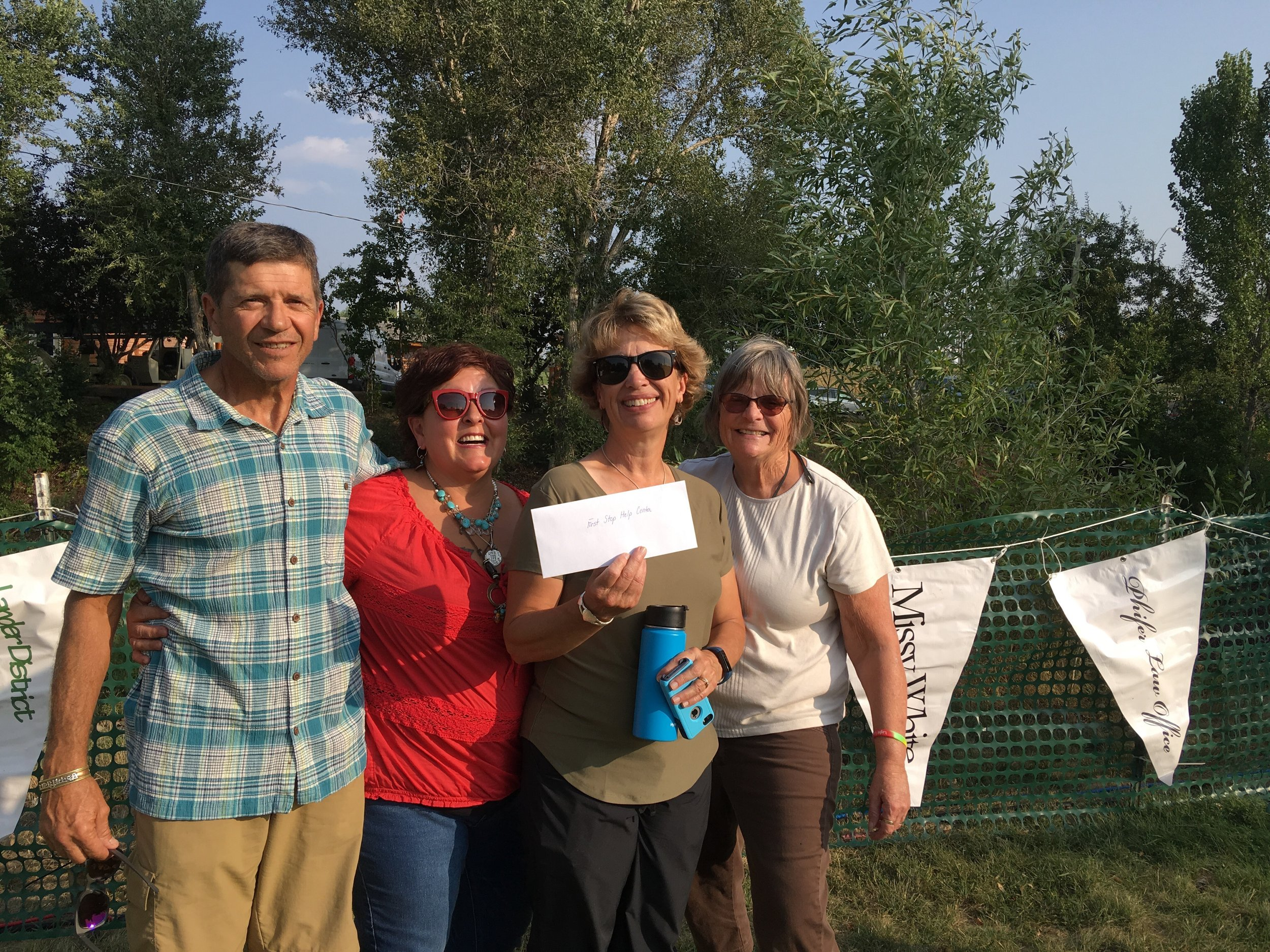 Paul Cornia, Tammy Green, Kristy Jones and Linda Hudson accept the check.