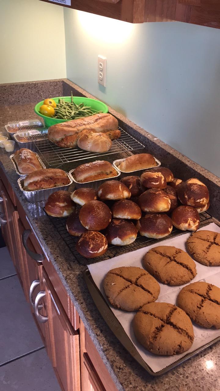 Homegrown green beans, pesto asiago bread, pretzel buns, and communion bread. Photo by Alice Connor.