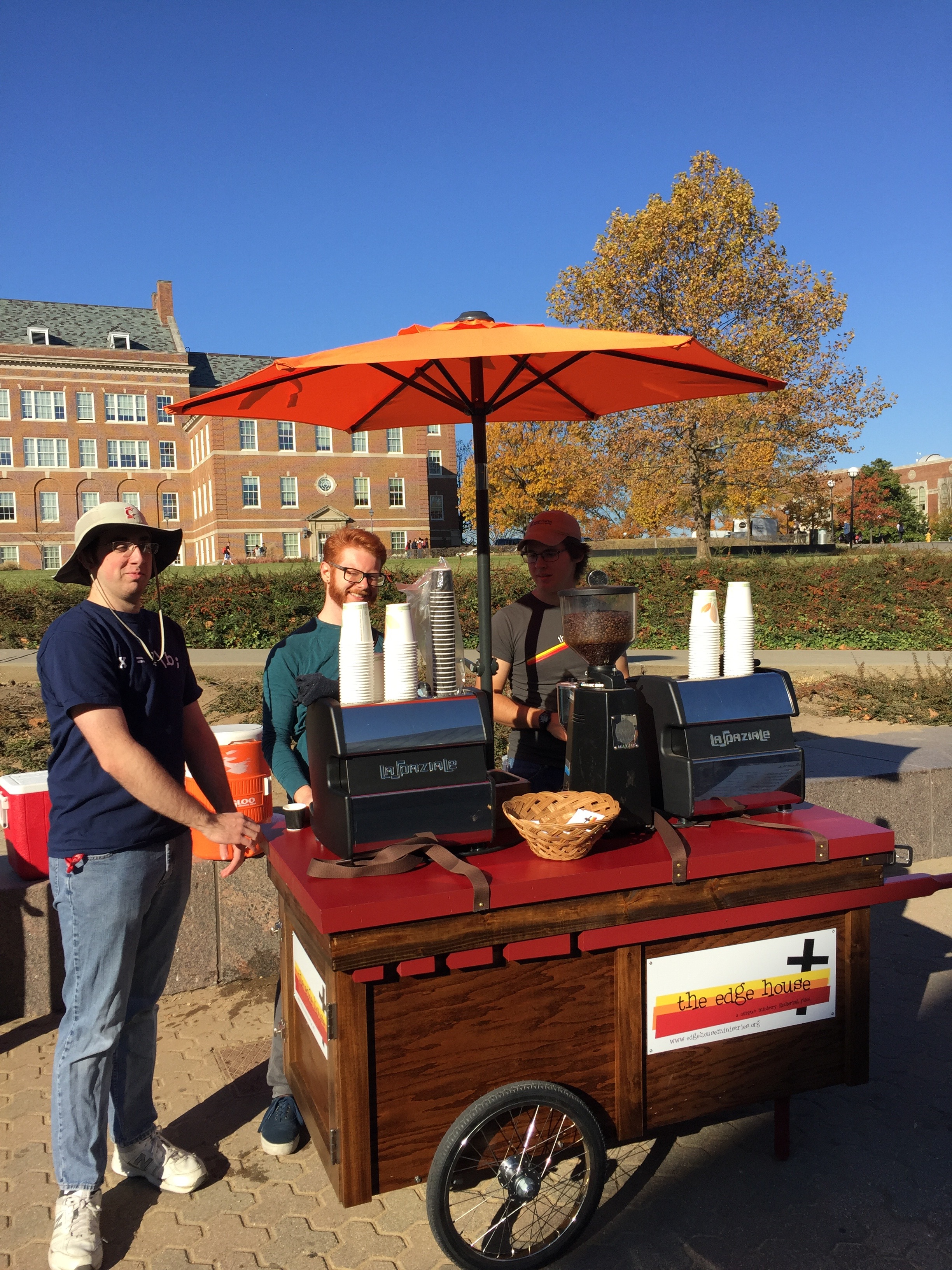 Seth, Ben, and Andrew giving away coffee. Cart designed and built by Andrew and Tres Kutcher. Photo by Alice Connor.