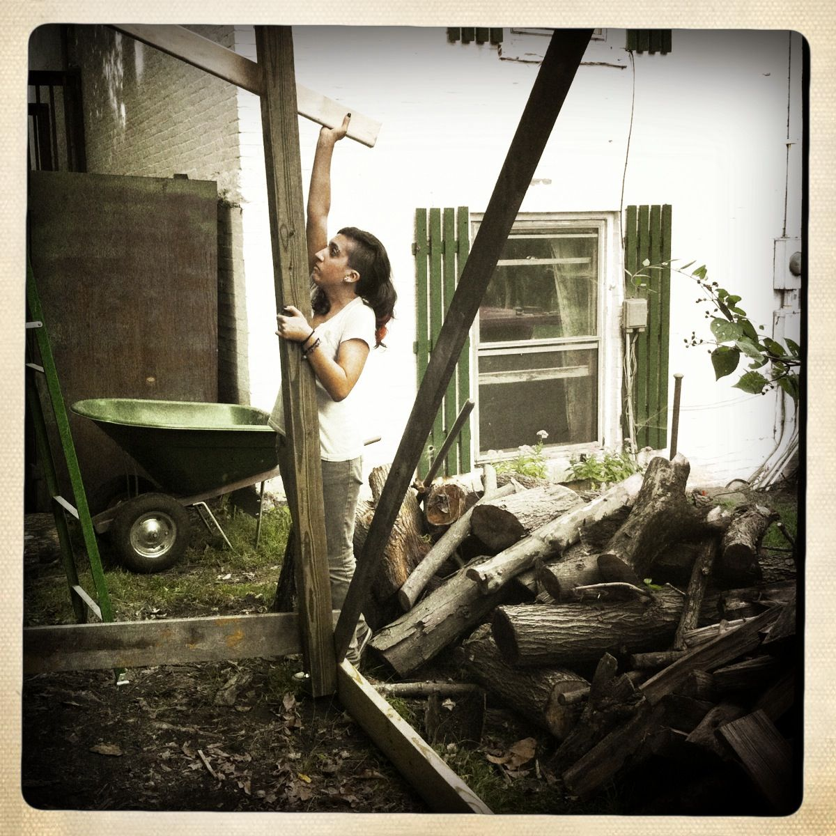 Sam helping build a firewood shelter in Athens, Ohio. Photo by Alice Connor.