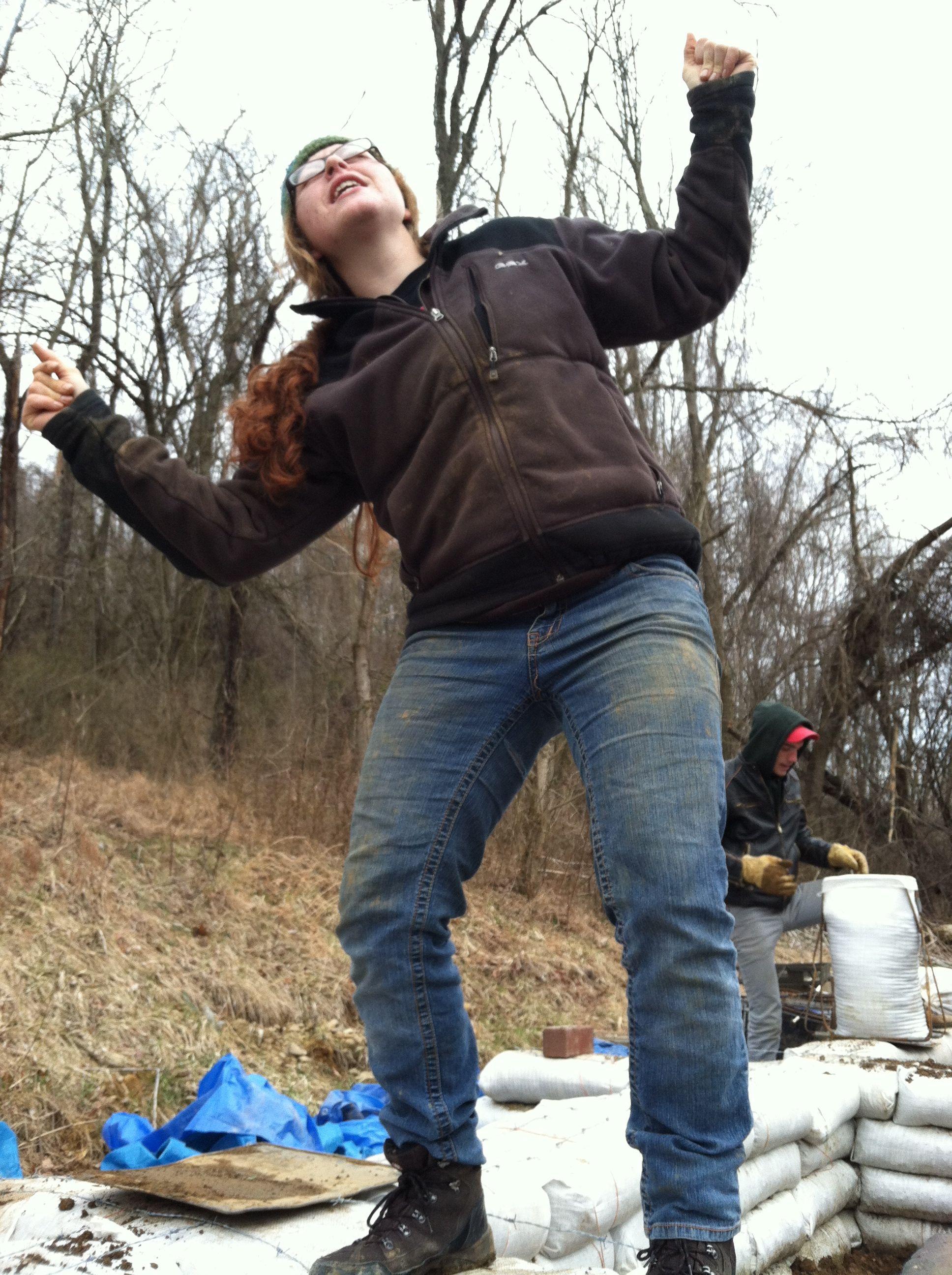 Liz dancing on the Good Earth chapel foundation