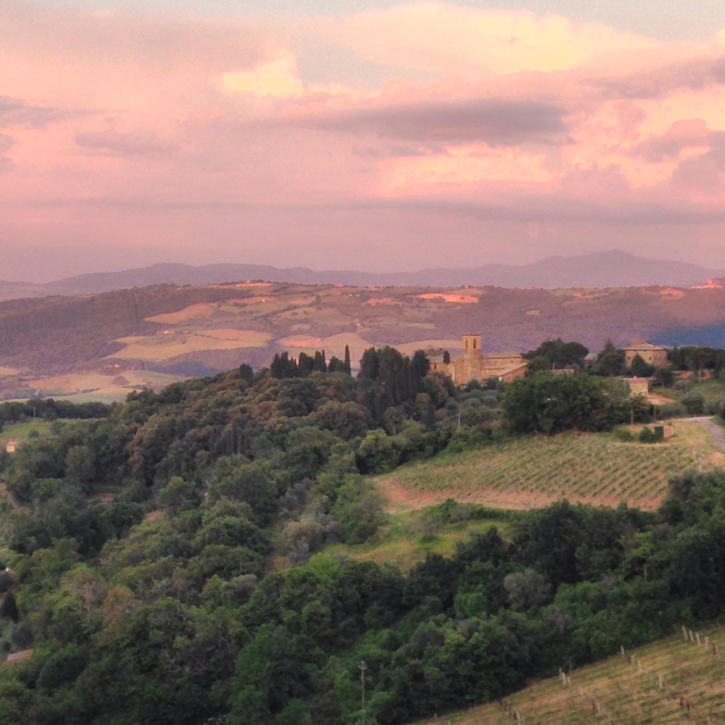 Pink sunset in Tuscany on a transformational travel experience