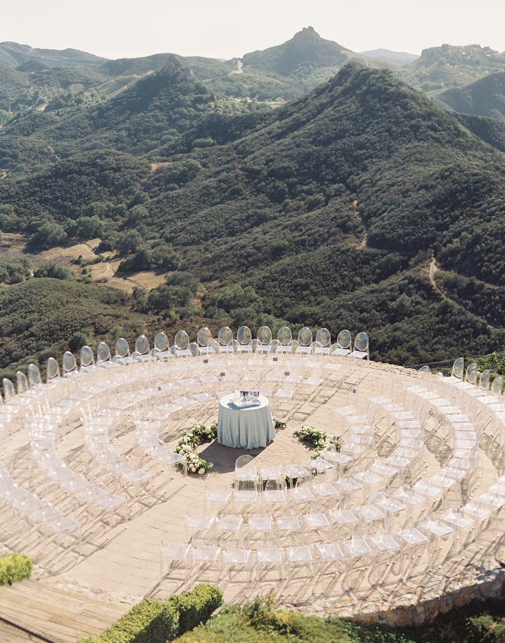 Circular wedding ceremony seating for an intimate wedding ceremony on the helipad of Malibu Rocky Oaks.
