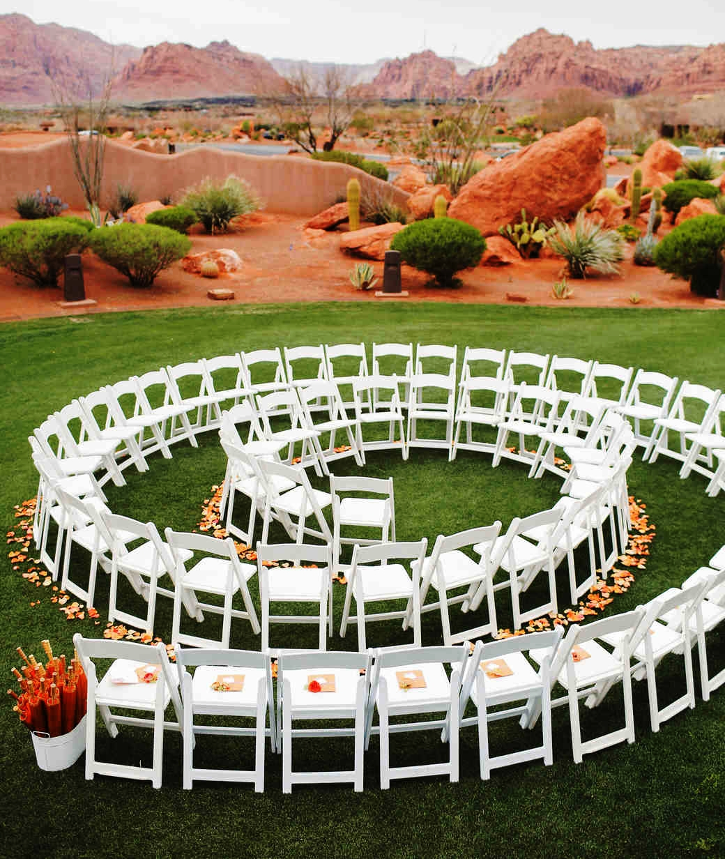 Unique swirl-shaped ceremony seating for an intimate wedding ceremony where the bride and groom must walk past every guest.