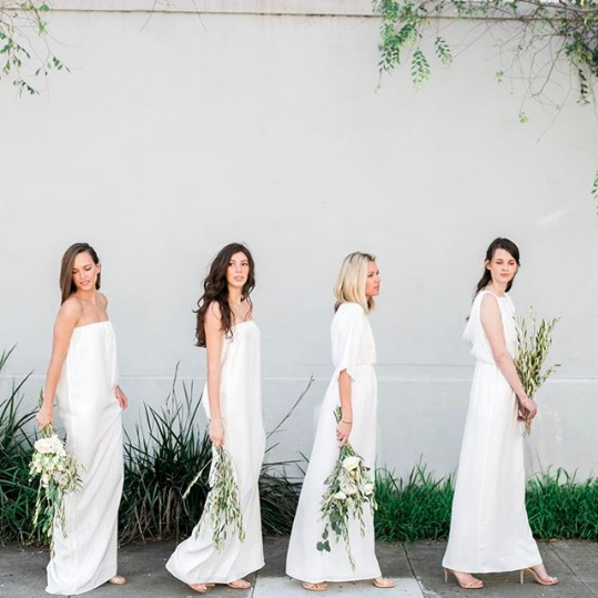 An all-white bridal party enhances the minimalist look.
