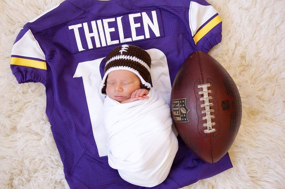 Asher with daddy's jersey and first TD ball