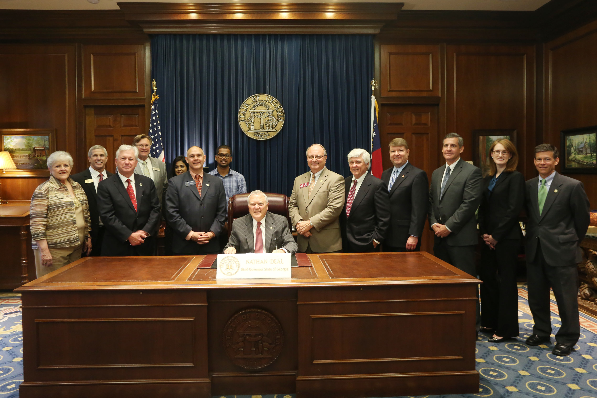 Sara Sorenson attends signing of HB 202 - May 5, 2015Sara worked with representatives of the Georgia Association of Assessing Officials (GAAO), Georgia Superior Court Clerk's Authority (GSCCA), the Association of County Commissioners of Georgia (ACCG), representatives from Georgia Tax Commisioners, and other Georgia attorneys to draft House Bill 202, which revised Georgia's property tax appeal procedure.