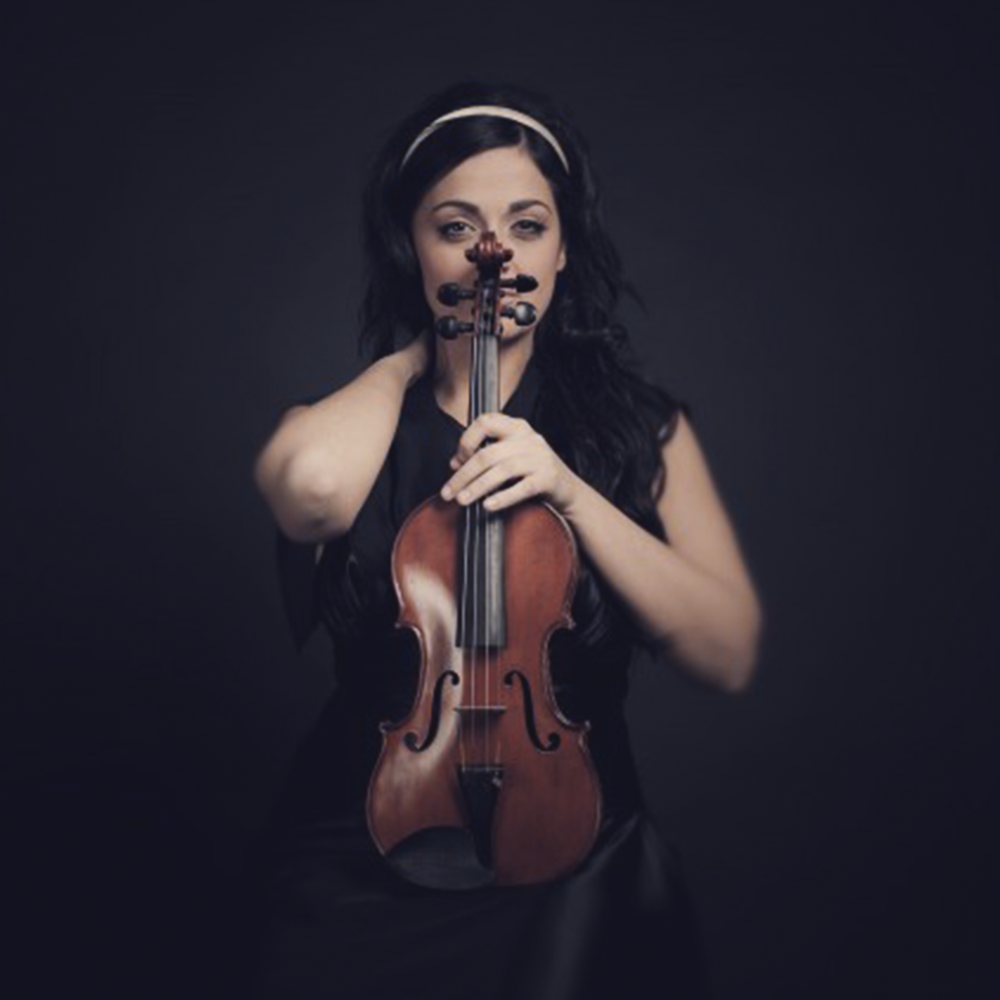 """Daniela is a born leader. Beautiful, intelligent, gracious, she exemplifies all the qualities as a soloist and a concertmaster at the highest levels of virtuosity.""     – John Axelrod, - prominent composer and conductor"