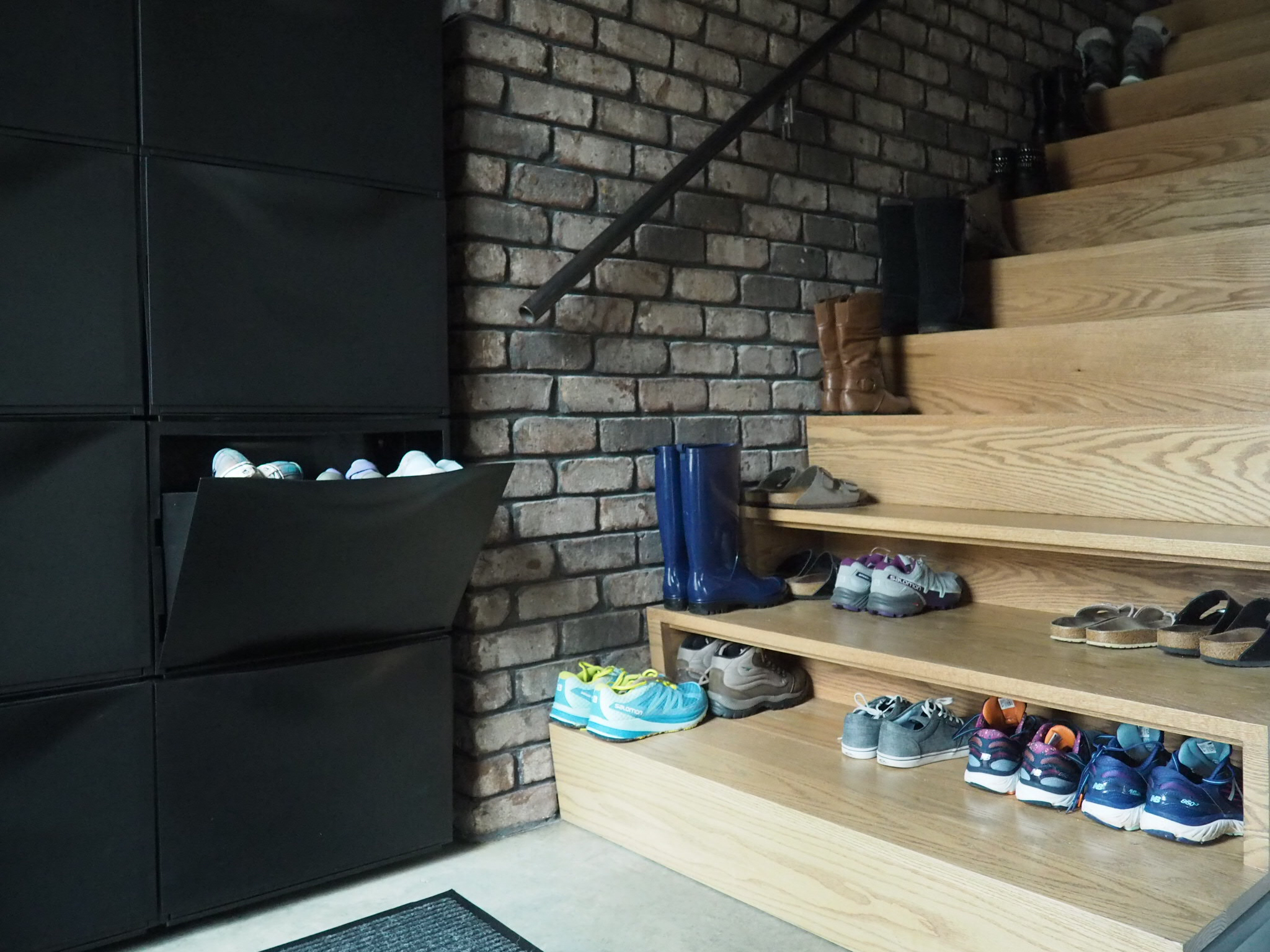 Plenty of shoe space and a place to sit and tie your shoes is given at the entry of the Witte Home.