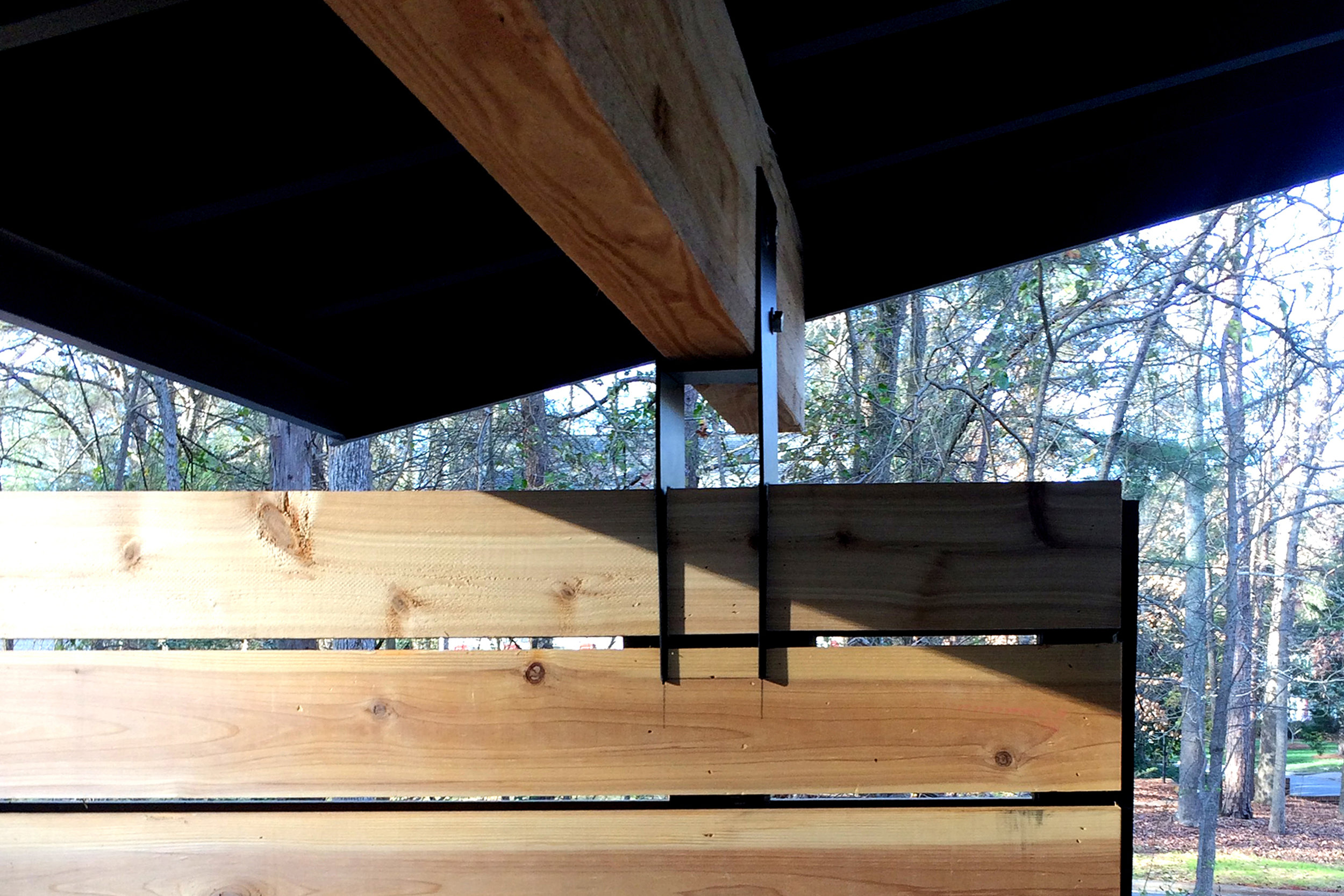 This steel bracket gets to hold up an 18 ft long architectural glulam beam by slicing through a slatted cedar wall. A light and airy touch to a heavy affair in my own home.