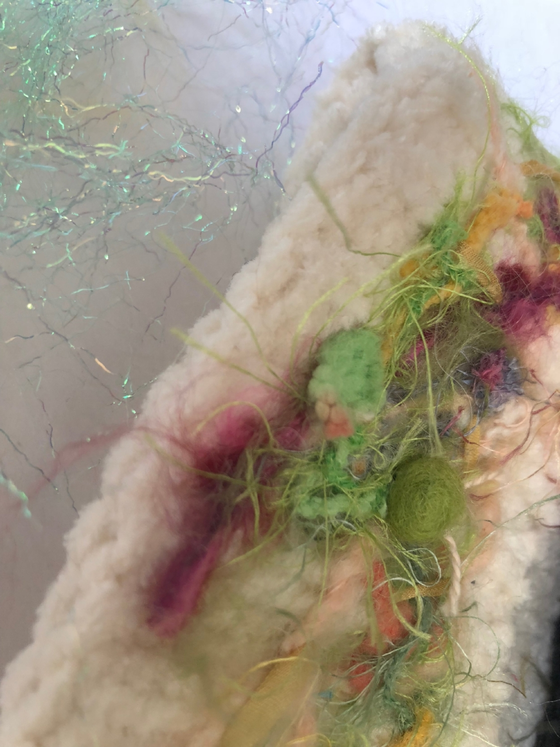 2 - After the felting, use buttons, beads, silk ribbon or small pom pons to add more texture and interest to your project. A tapestry needle and heavy thread, string or yarn will make sure your embellishments stay in place!