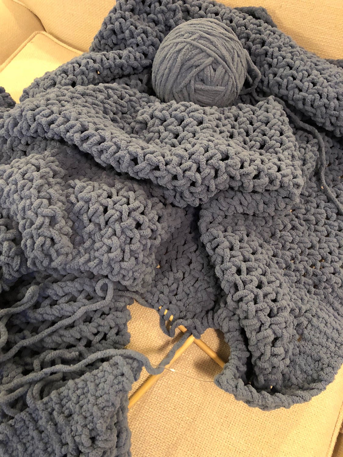 Chunky yarn hand knitted throw with knitting needles