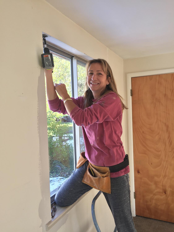 Ashley installing window hardware