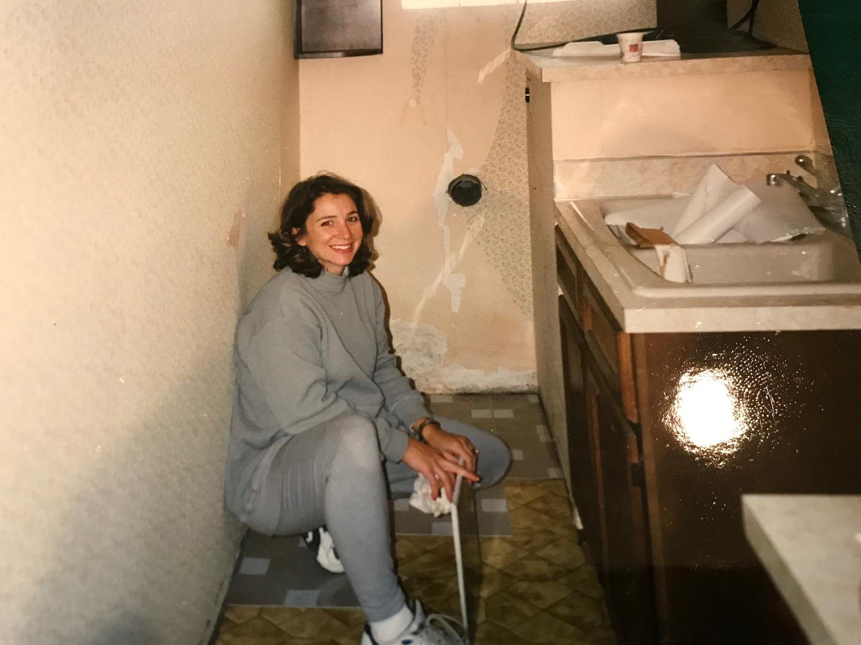 Ashley installing floor tiles