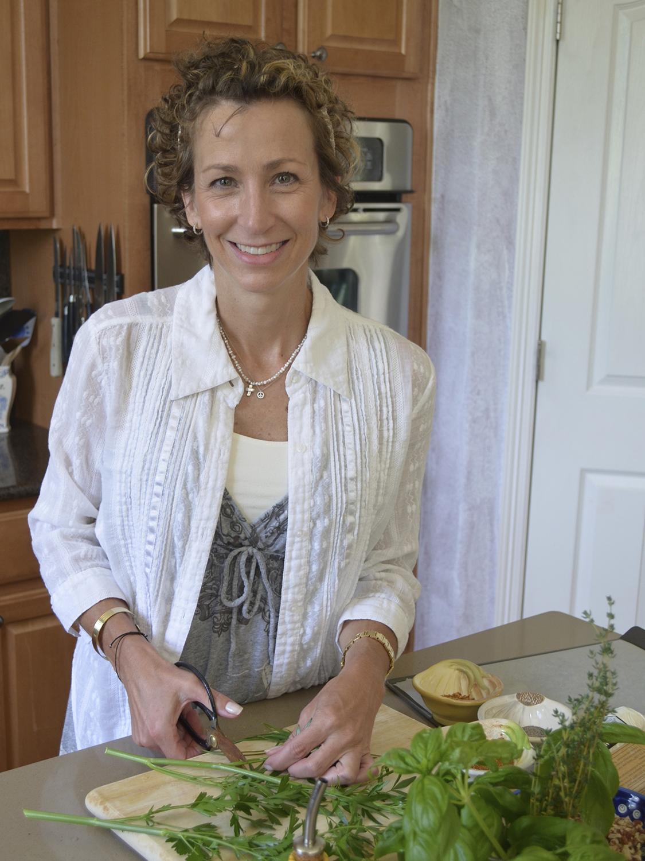 Ashley preparing fresh herbs in the kitchen
