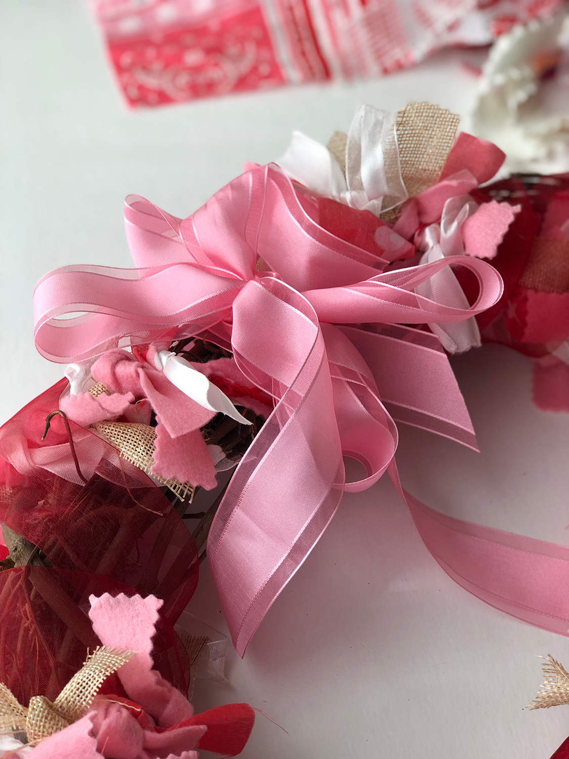 Pink ribbon bow on wreath