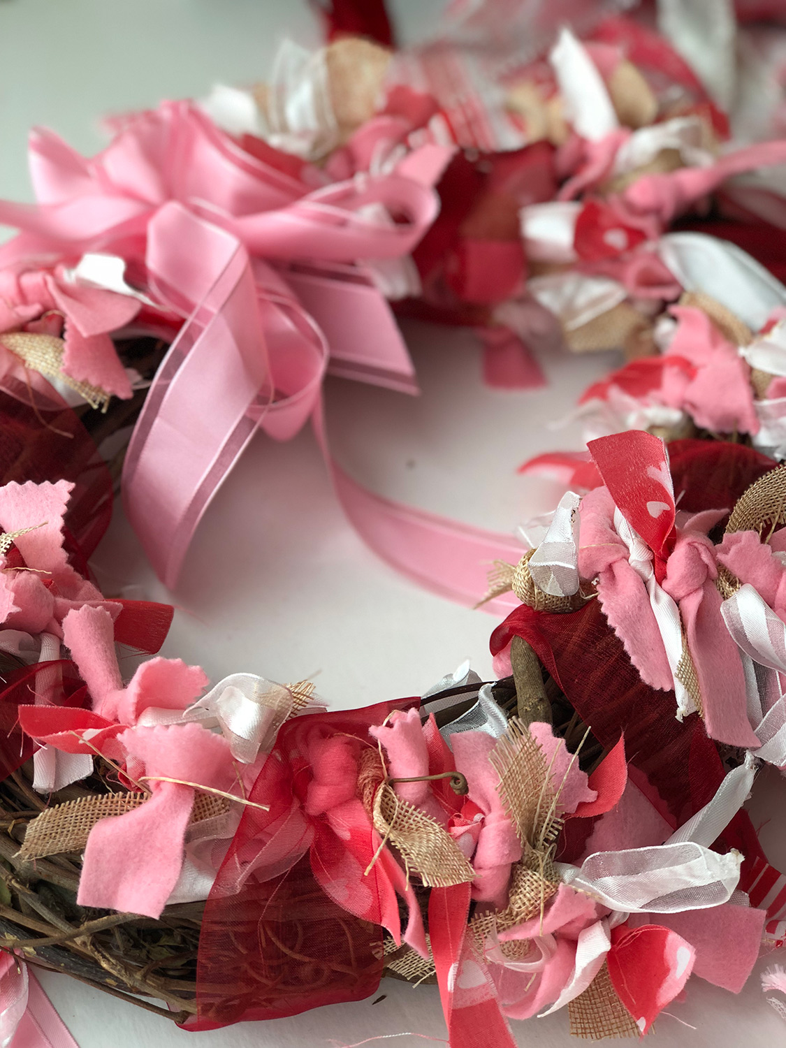 sheer red ribbon on wreath