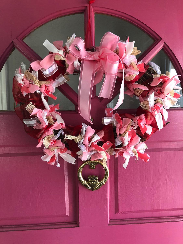Hand made DIY ribbon wreath on pink door