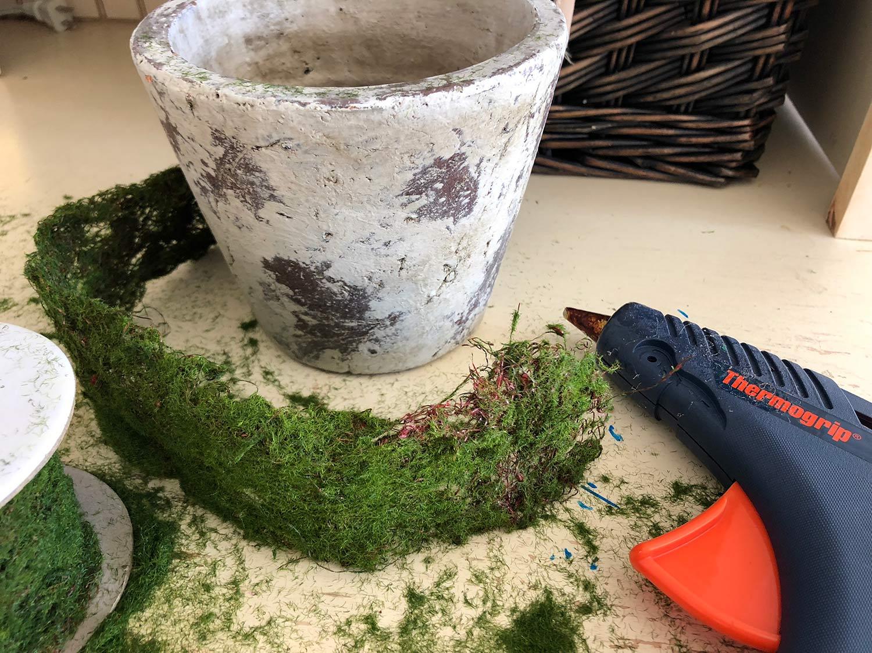 moss ribbon, pot, and glue gun