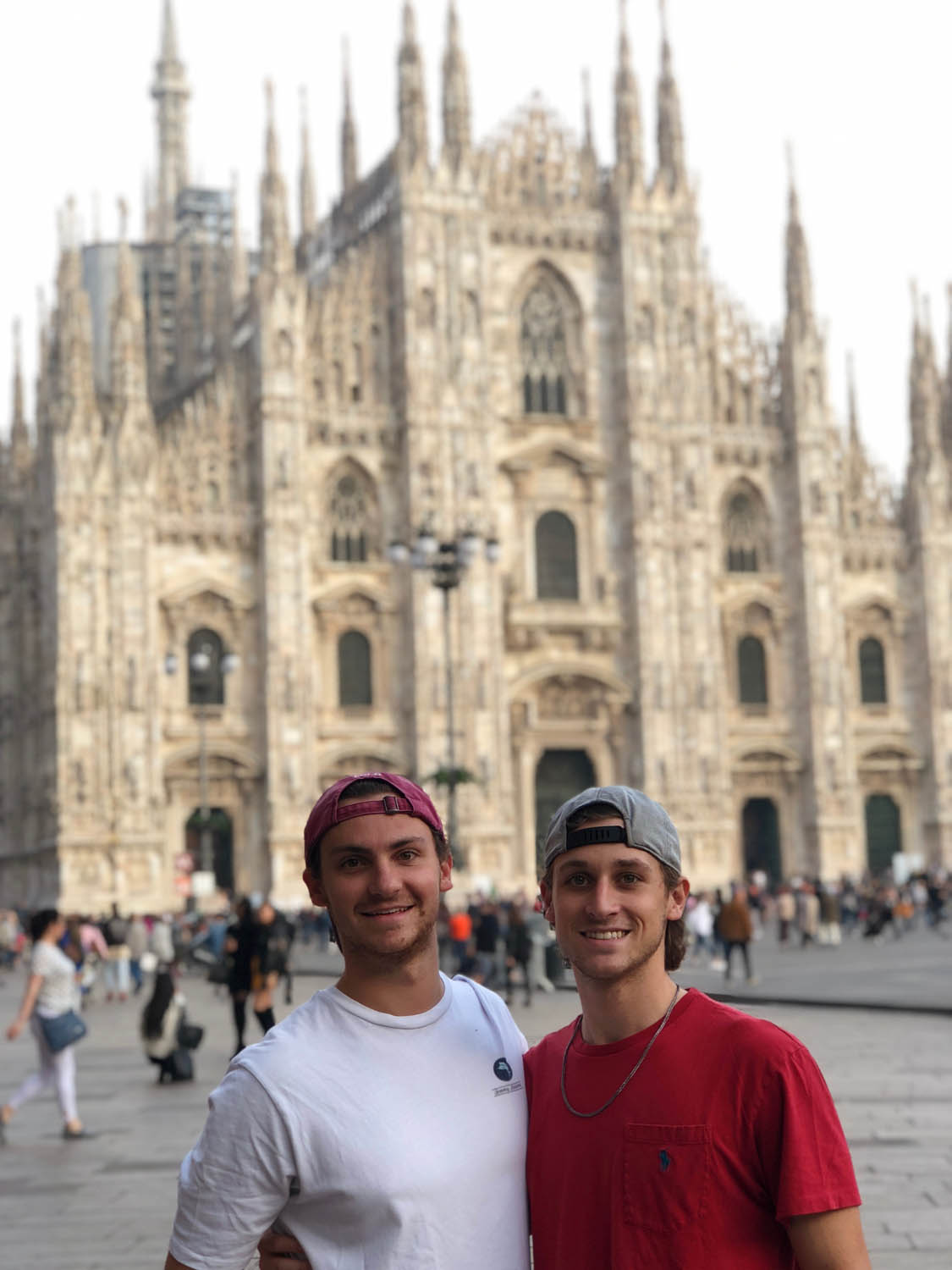 Young men in front of Italian cathedral