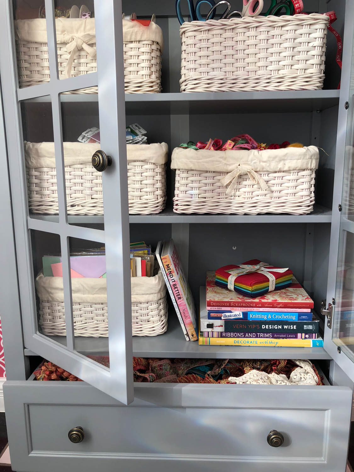 painted craft storage baskets on shelves