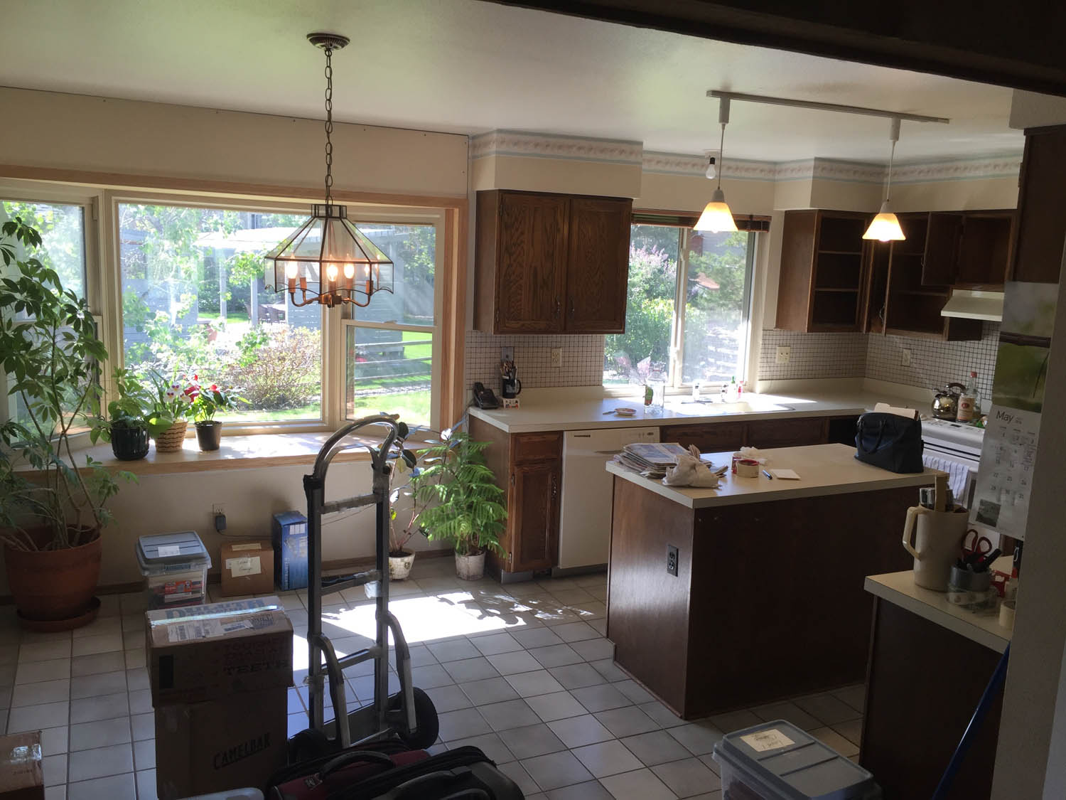 Kitchen remodel: before, with soffits above cabinets