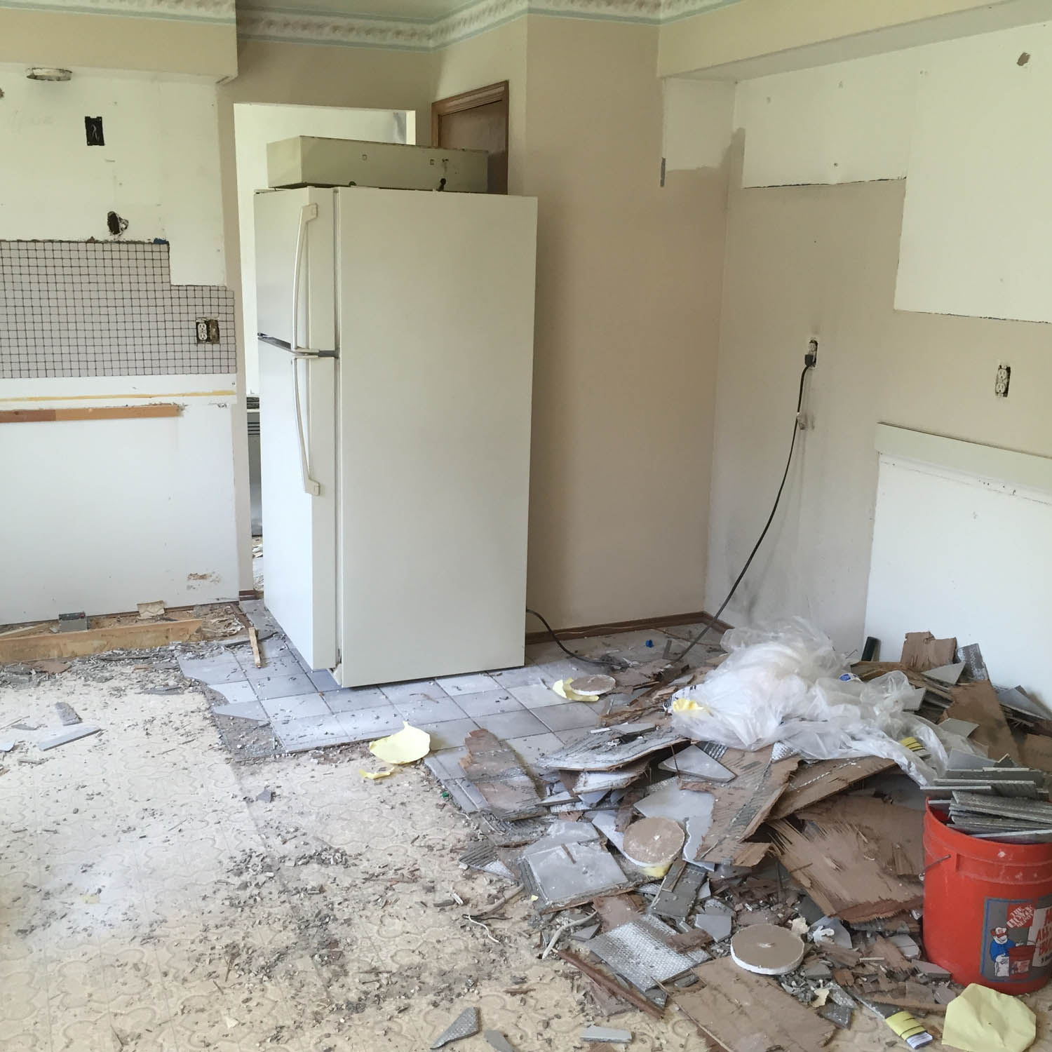 Kitchen remodel, tearing out old flooring