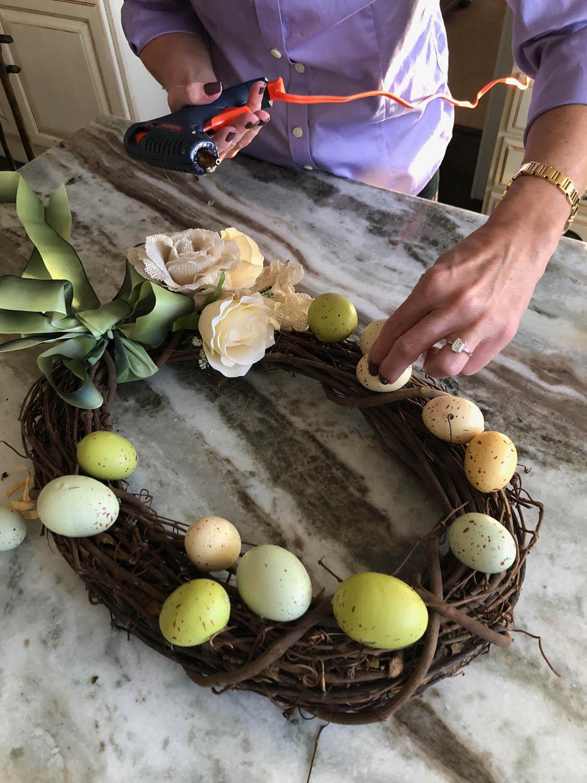 Use hot glue to attach eggs