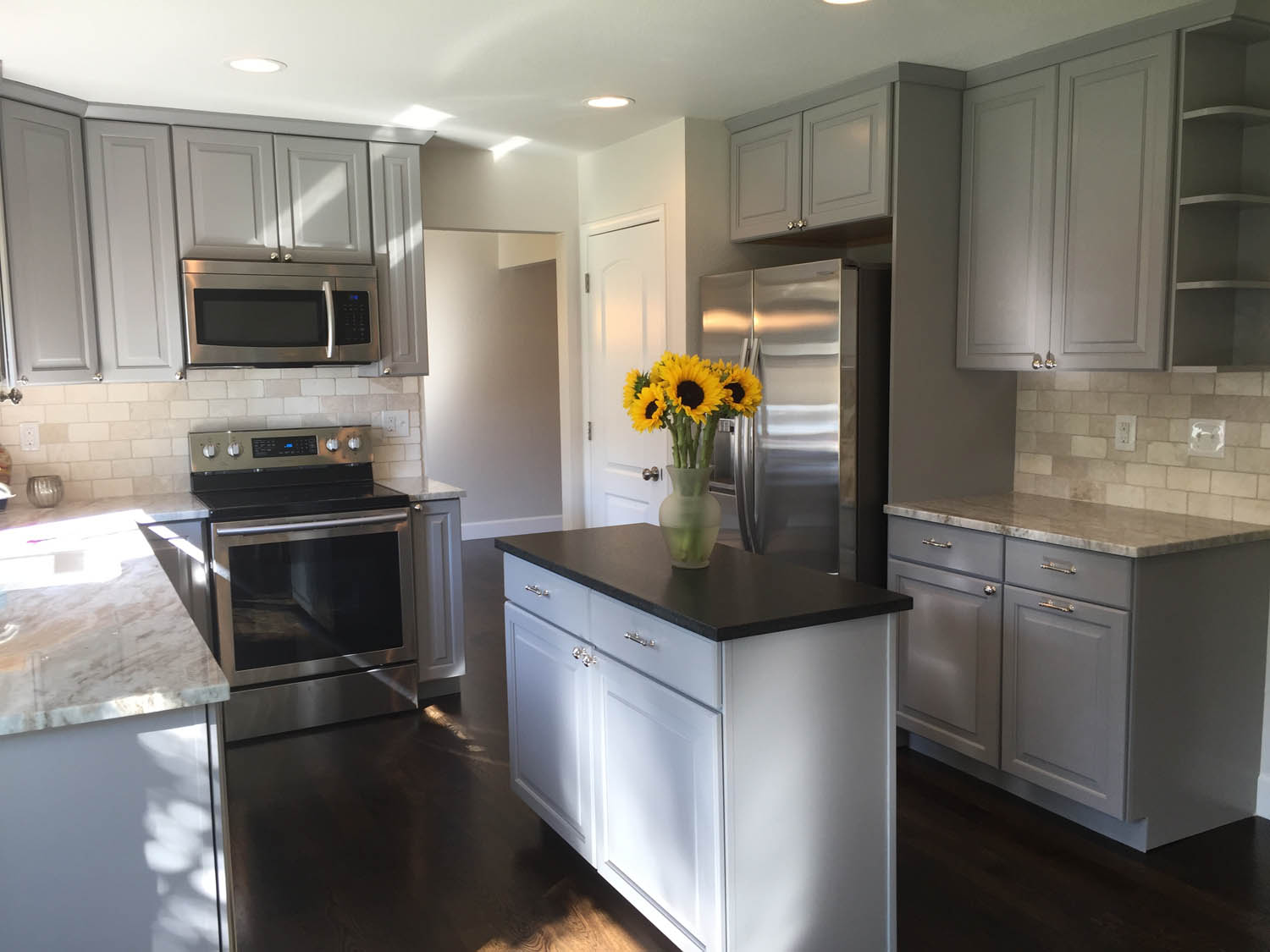 New cabinets give a light, bright appeal to the dark kitchen